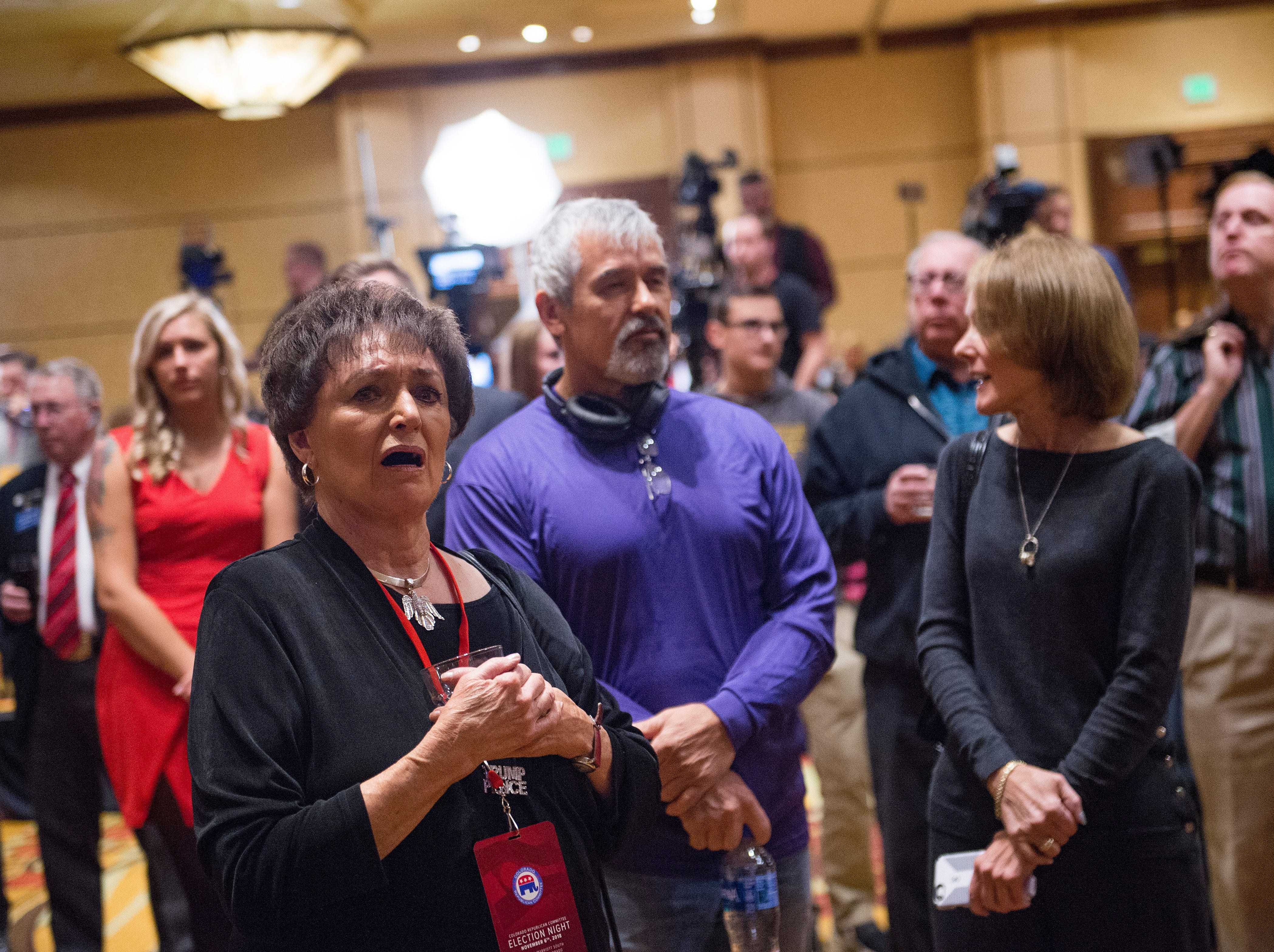 People react to early voting results during a Colorado GOP watch party at the Denver Marriott South at Park Meadows in Lone Tree on Election Day, Tuesday, November 6, 2018.