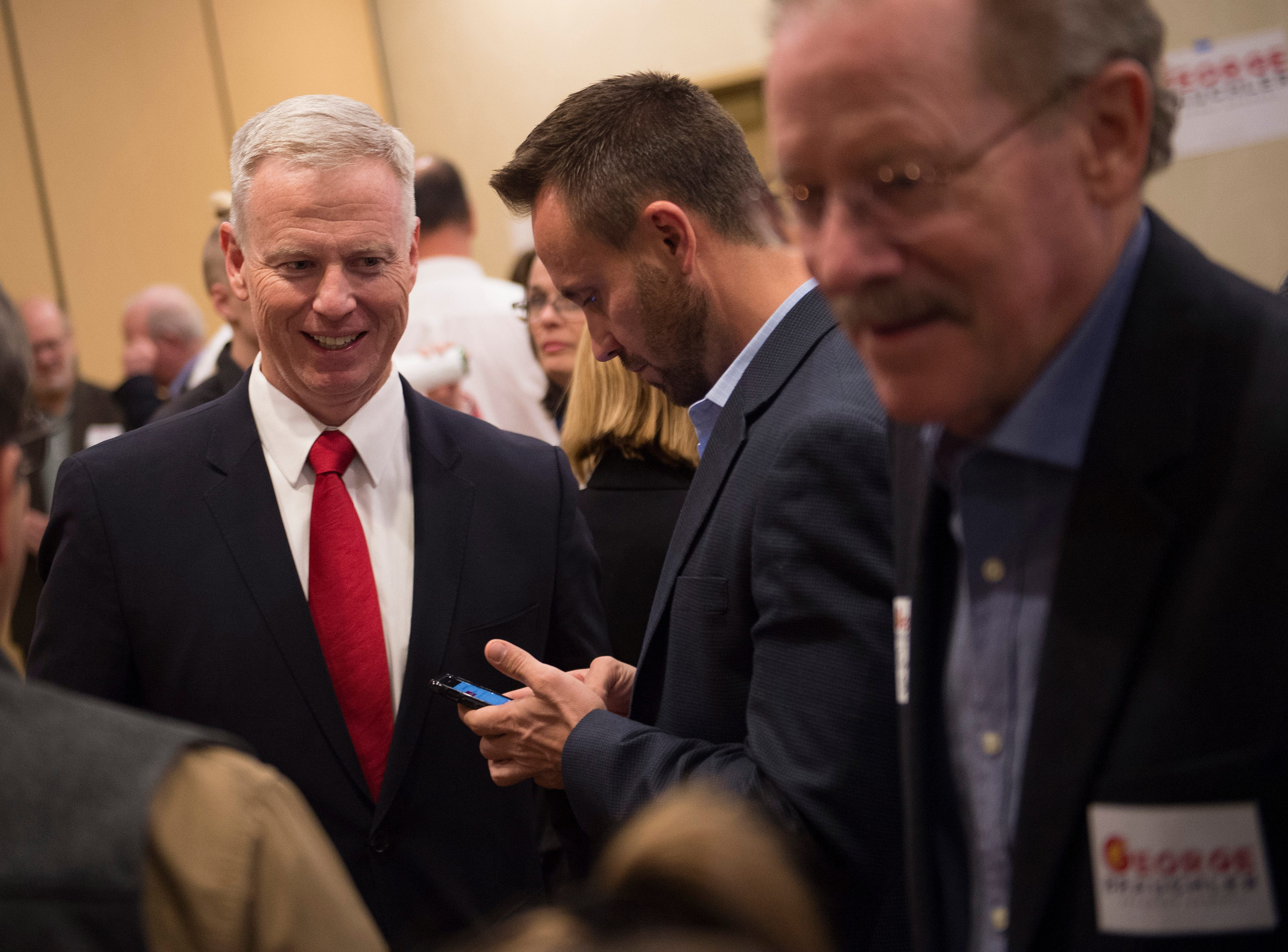 Colorado attorney general candidate George Brauchler talks with supporters during a Colorado GOP watch party at the Denver Marriott South at Park Meadows in Lone Tree on Election Day, Tuesday, November 6, 2018.