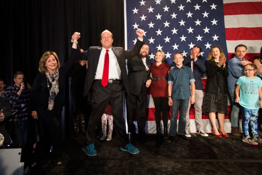 Democratic candidate for Colorado governor Jared Polis lifts his and Lieutenant Governor elect Dianne Primavera's hands after Republican candidate Walker Stapleton conceded the race on Tuesday, Nov. 6, 2018, at the Westin Denver Downtown hotel in Denver, Colo.