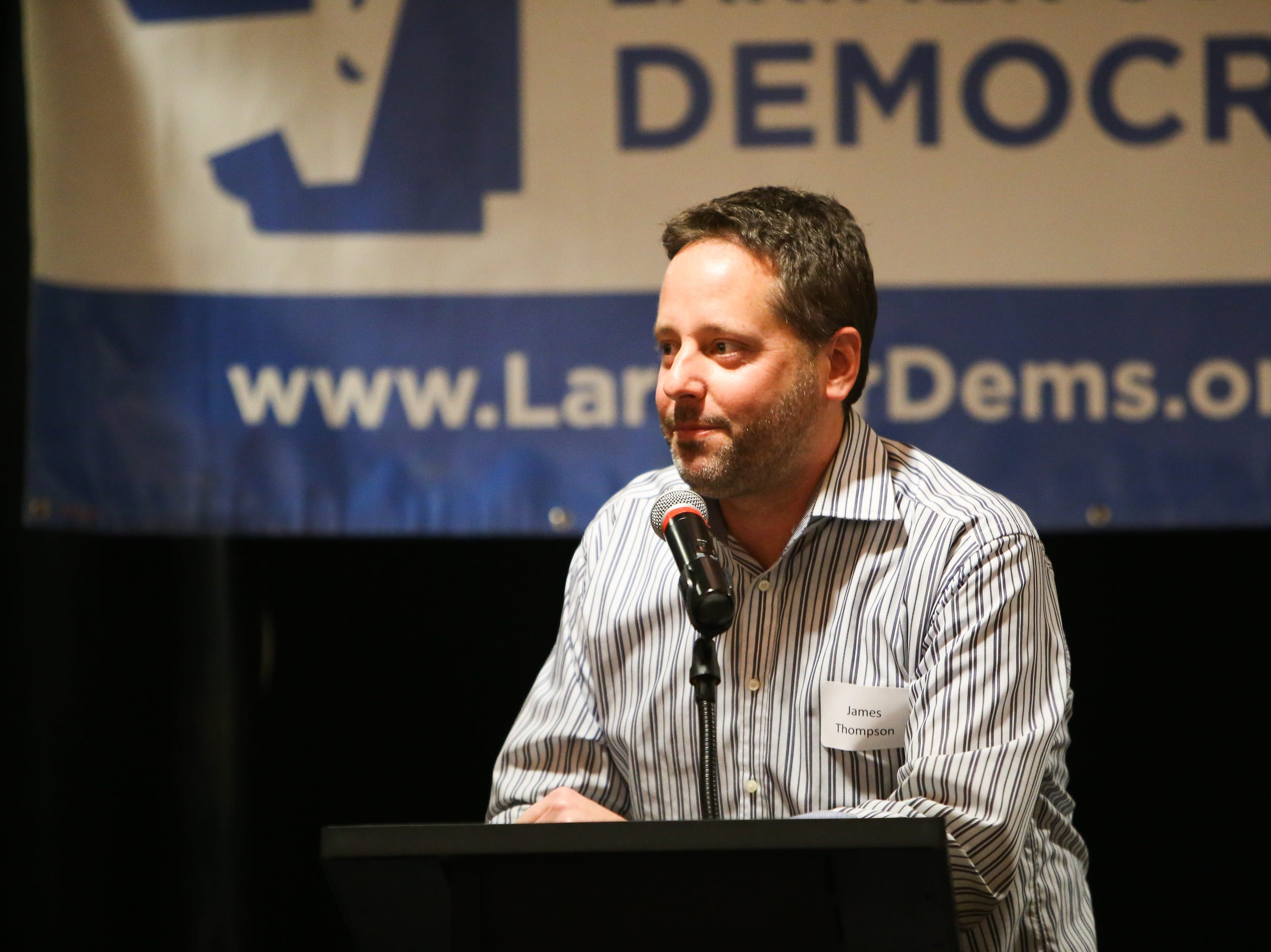 Jared Thompson, chairman of the Larimer County Democrats, welcomes guests to the watch party on Nov. 6 at the Fort Collins Marriott.