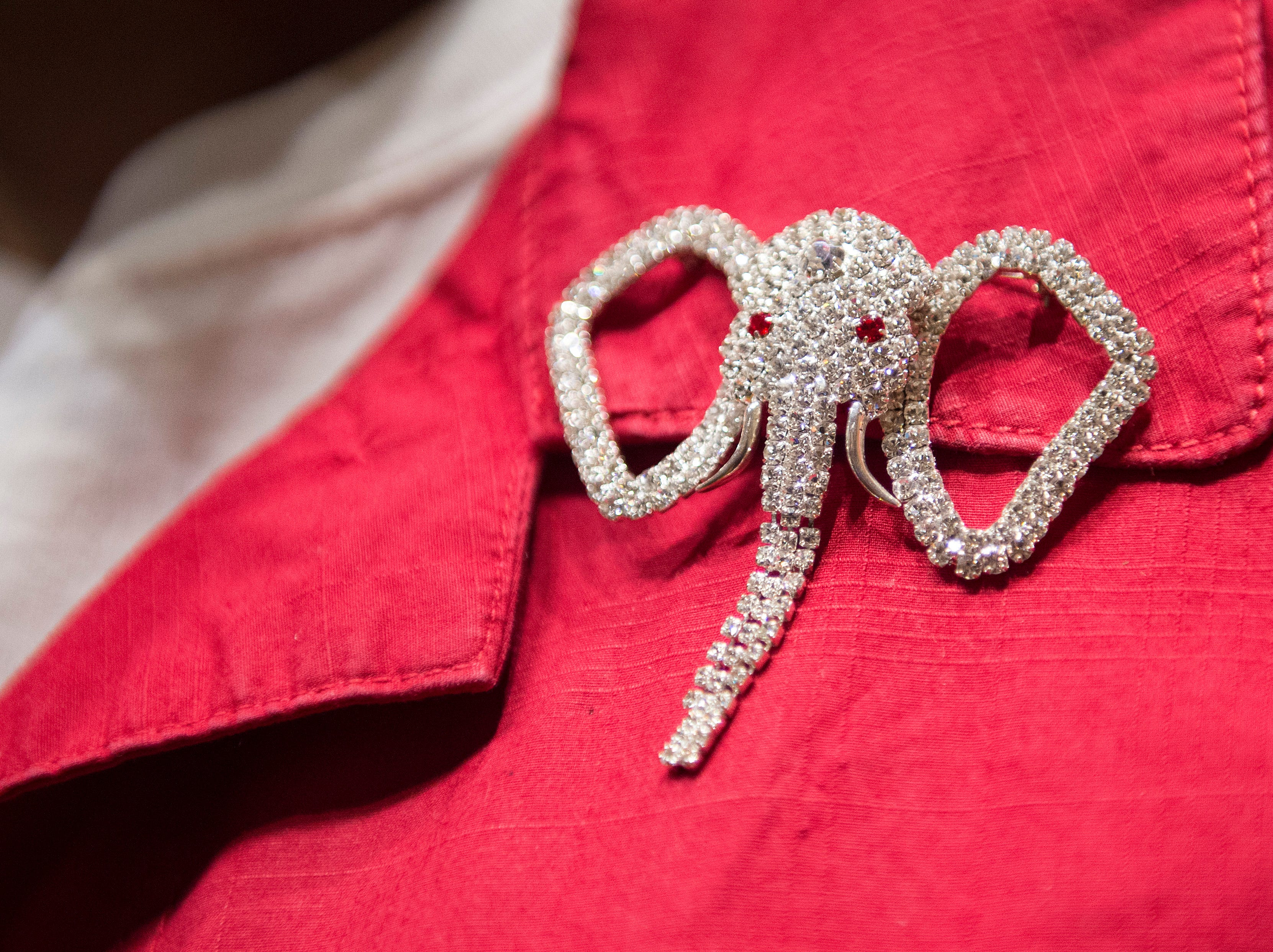 A woman wears an elephant broche during a Colorado GOP watch party at the Denver Marriott South at Park Meadows in Lone Tree on Election Day, Tuesday, November 6, 2018.