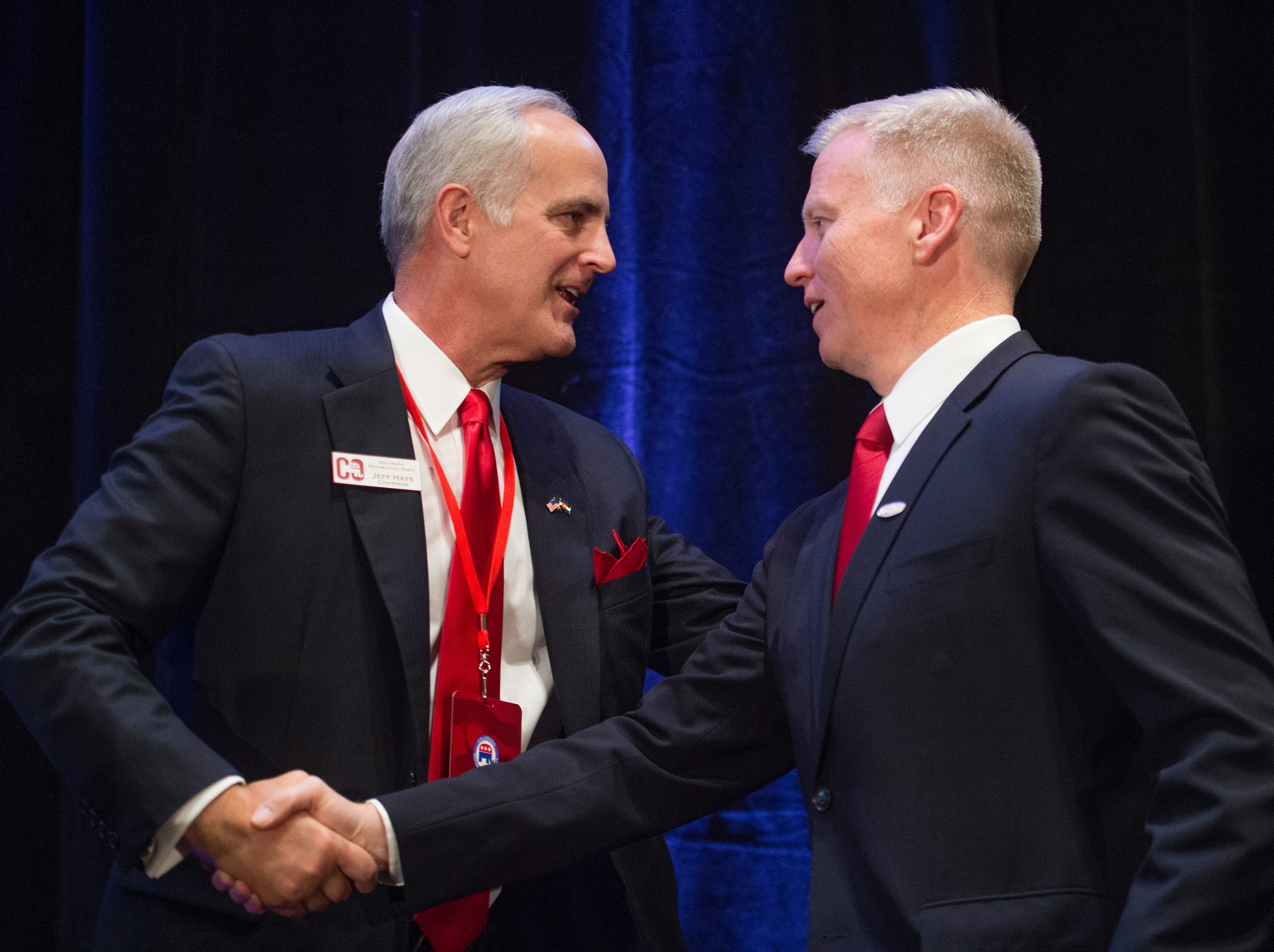 Colorado GOP chairman Jeff Hays shakes the hand of Colorado attorney general candidate George Brauchler before he speaks during a Colorado GOP watch party at the Denver Marriott South at Park Meadows in Lone Tree on Election Day, Tuesday, November 6, 2018.