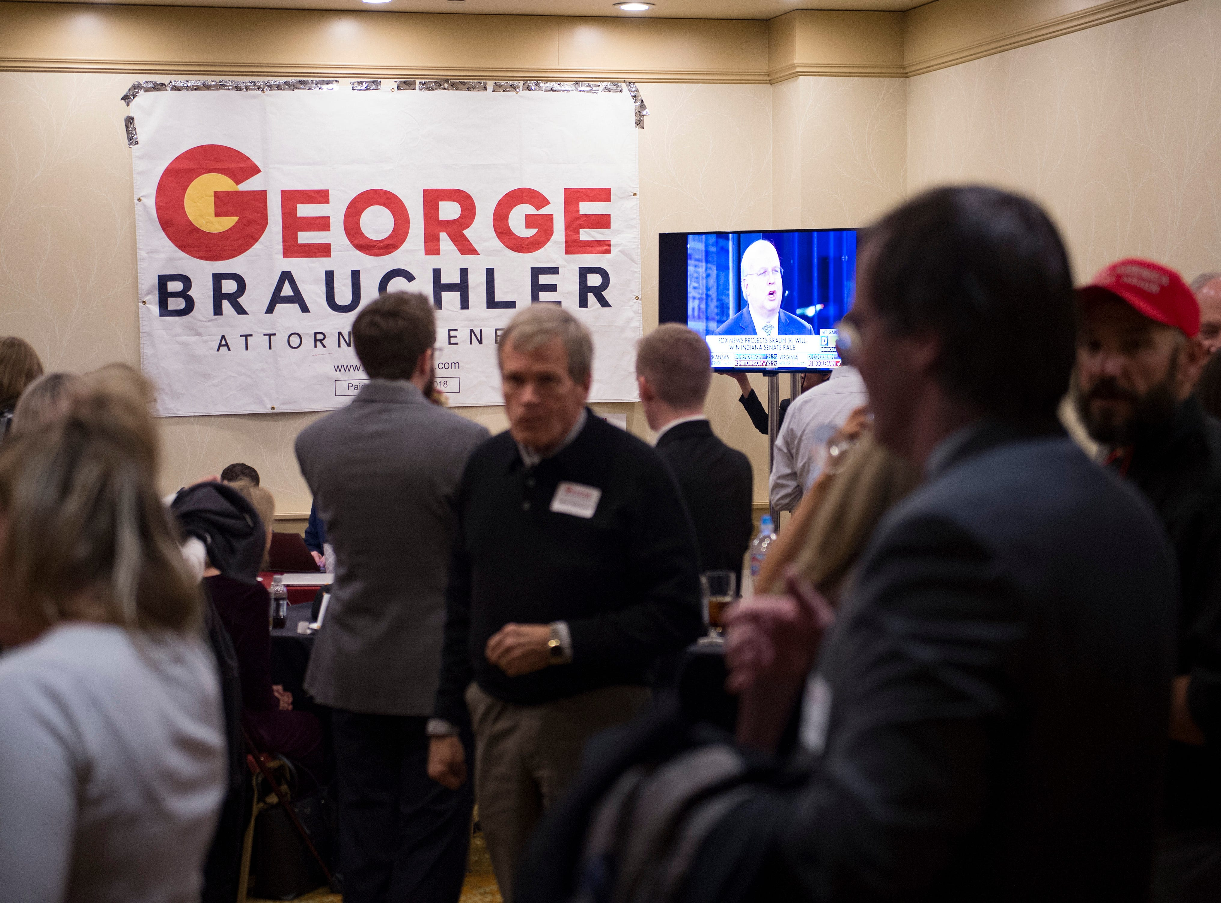 Supporters of Colorado attorney general candidate George Brauchler gather during a Colorado GOP watch party at the Denver Marriott South at Park Meadows in Lone Tree on Election Day, Tuesday, November 6, 2018.