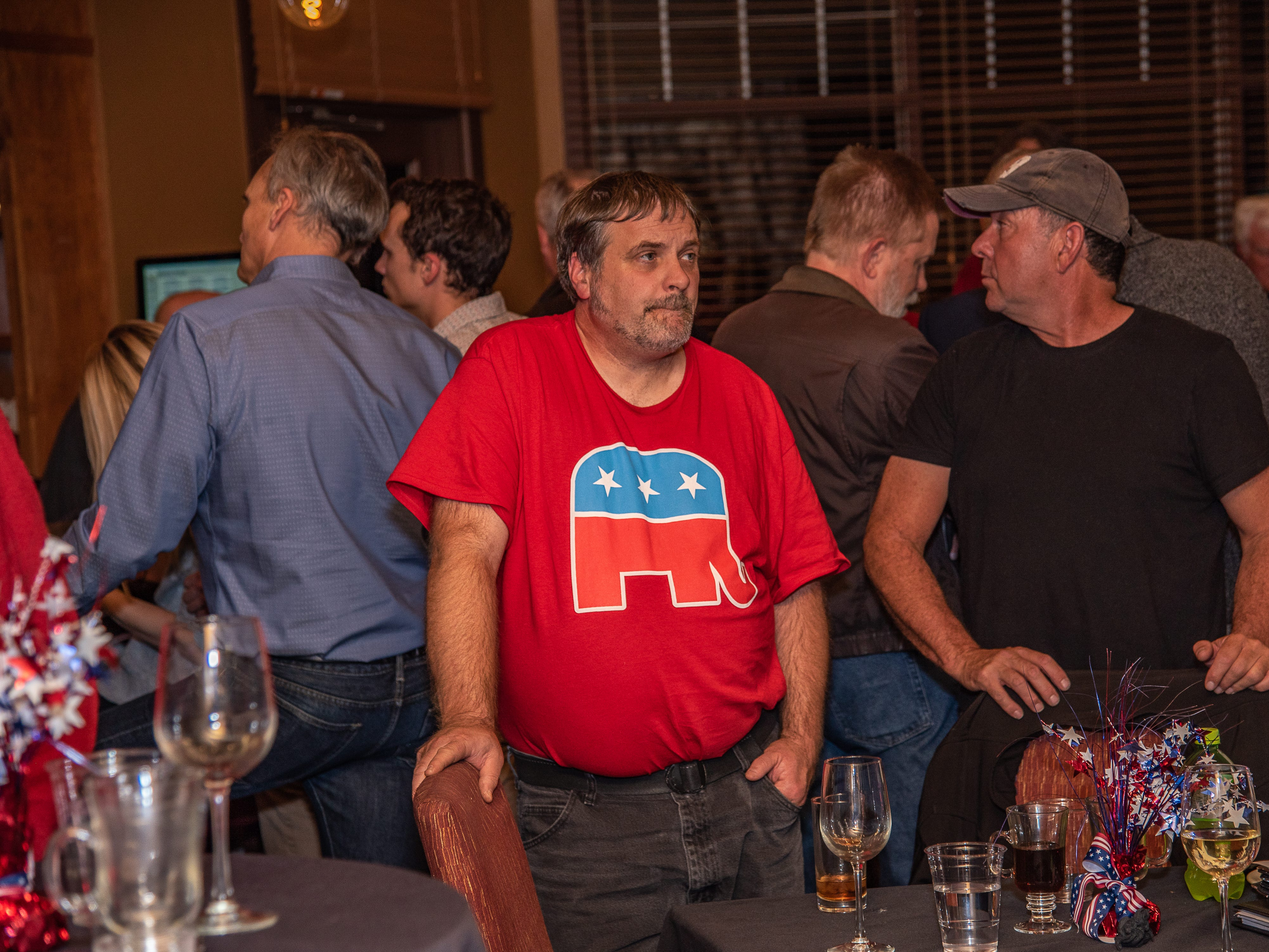 A GOP supporter reacts to early election results at a watch party on Tuesday, November 6, 2018, at Ptarmigan Country Club in Fort Collins, Colo.