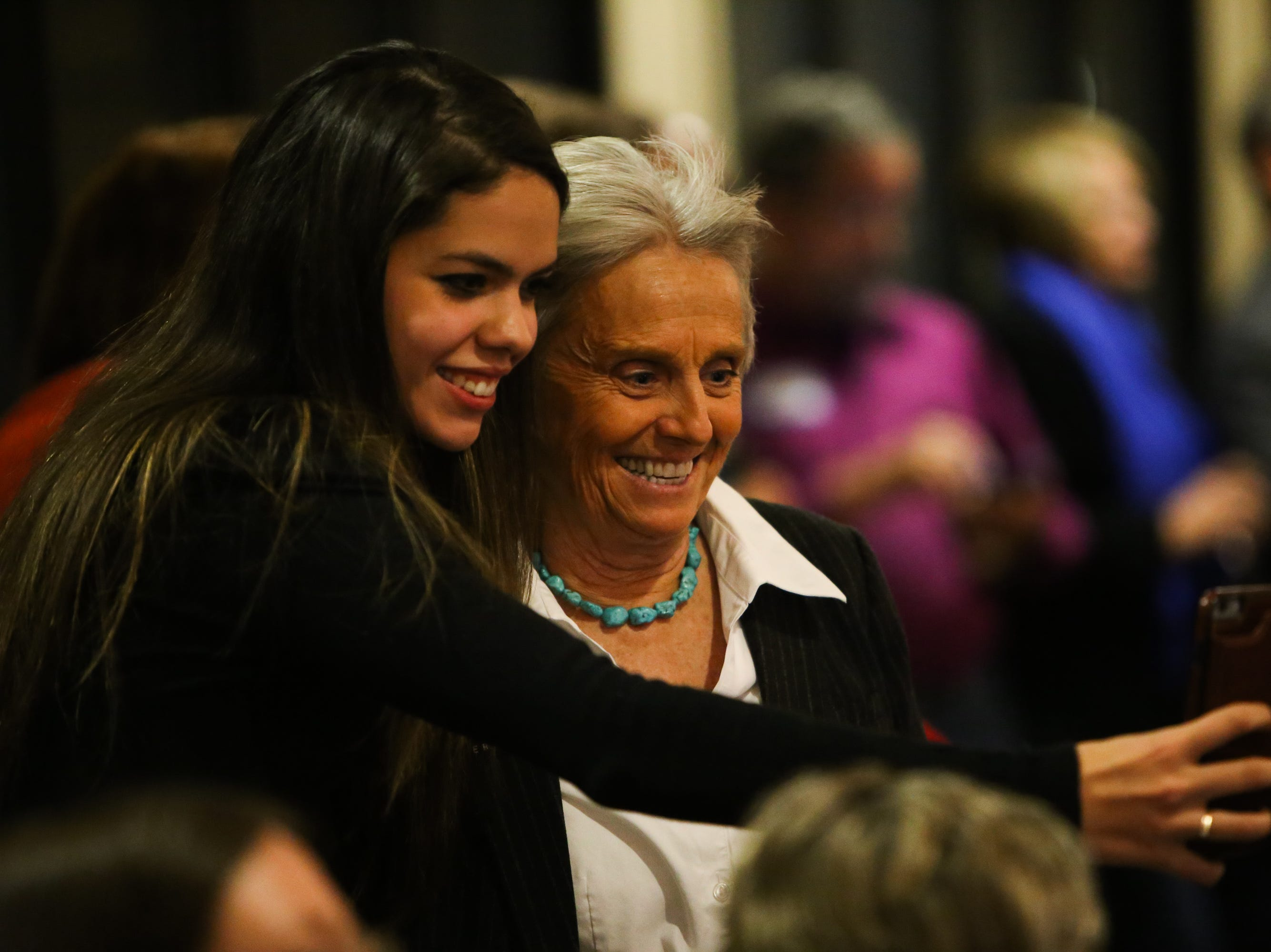 Ximena Meissgeier takes a selfie with Rep. Joann Ginal during the Larimer County Democrats Watch Party on Tuesday at the Fort Collins Marriott.