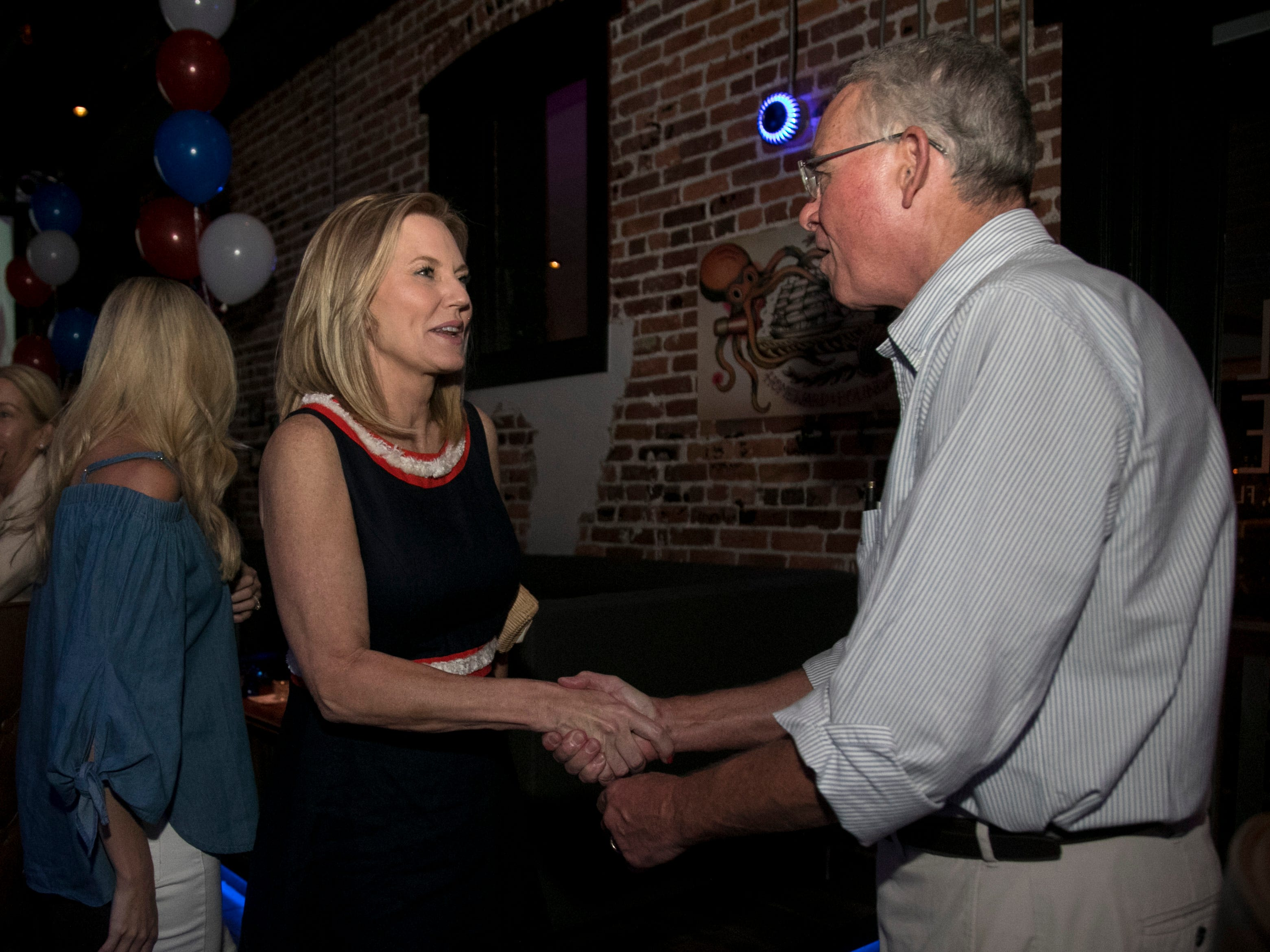 Francis Rooney visits with state Rep. Heather Fitzenhagen on Tuesday night at her election party in Fort Myers.