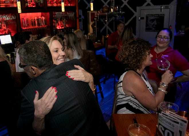 Ralph Garramone hugs state Rep. Heather Fitzenhagen after her win Tuesday night during her election watch party at the Downtown Social House in Fort Myers.