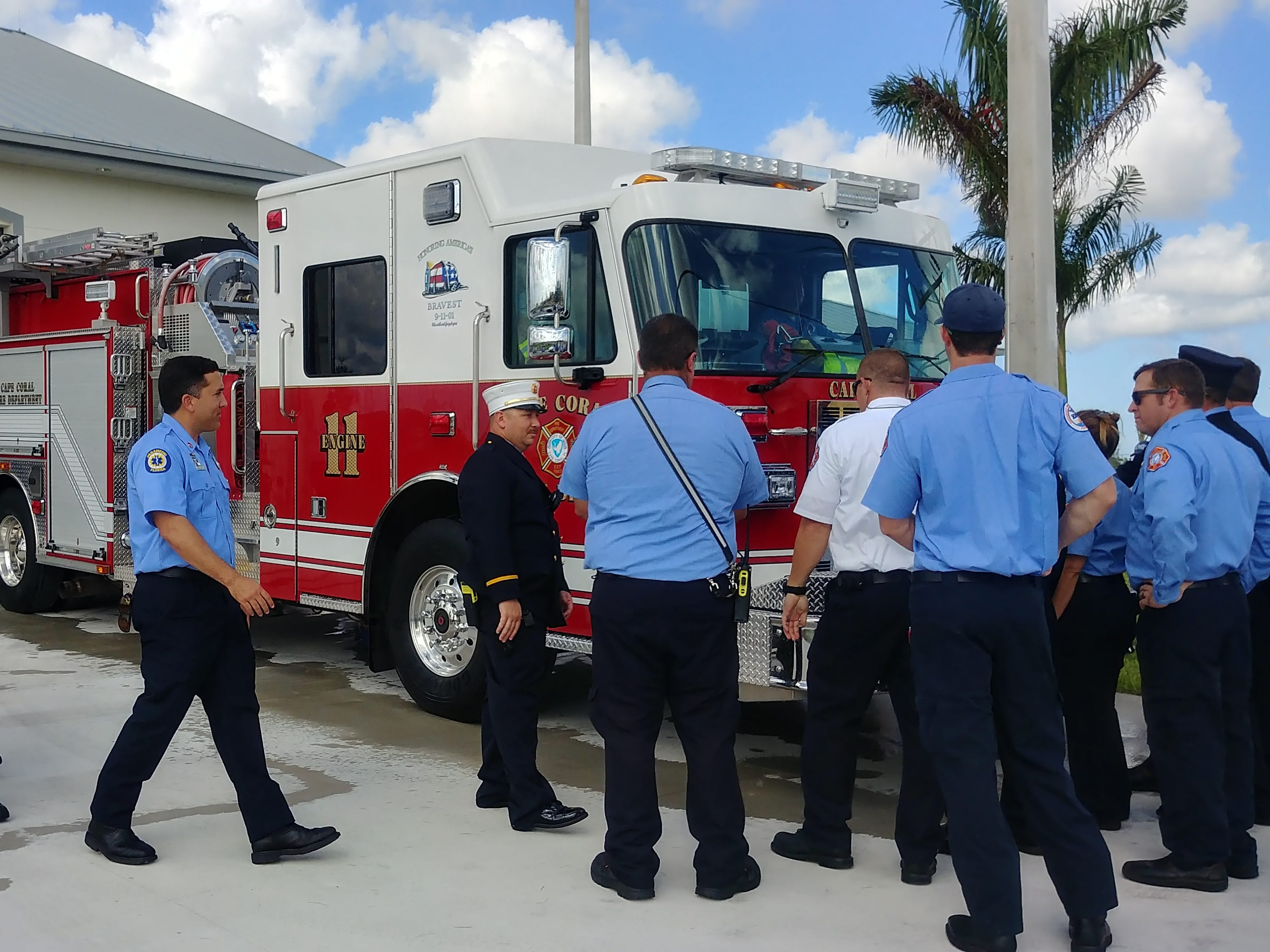 """Cape Coral firefighters gather to push Engine 11 into the bay at Station 11 during """"homing"""" ceremony for the truck. The station opened Wednesday under budget and earlier than planned."""