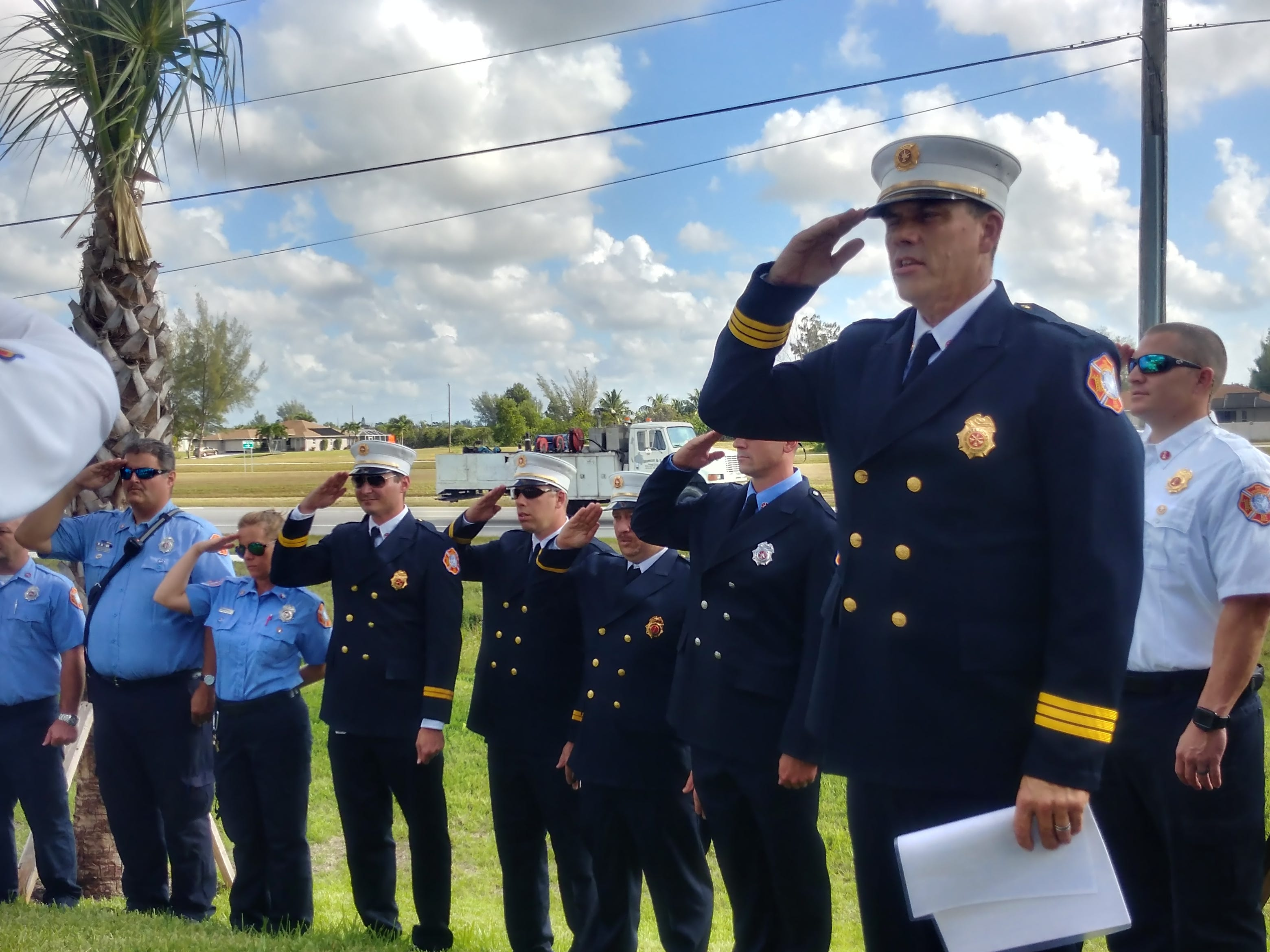 The Cape Coral Fire Department salutes during the Pledge of Allegiance during ground-breaking  ceremonies for Station 11.