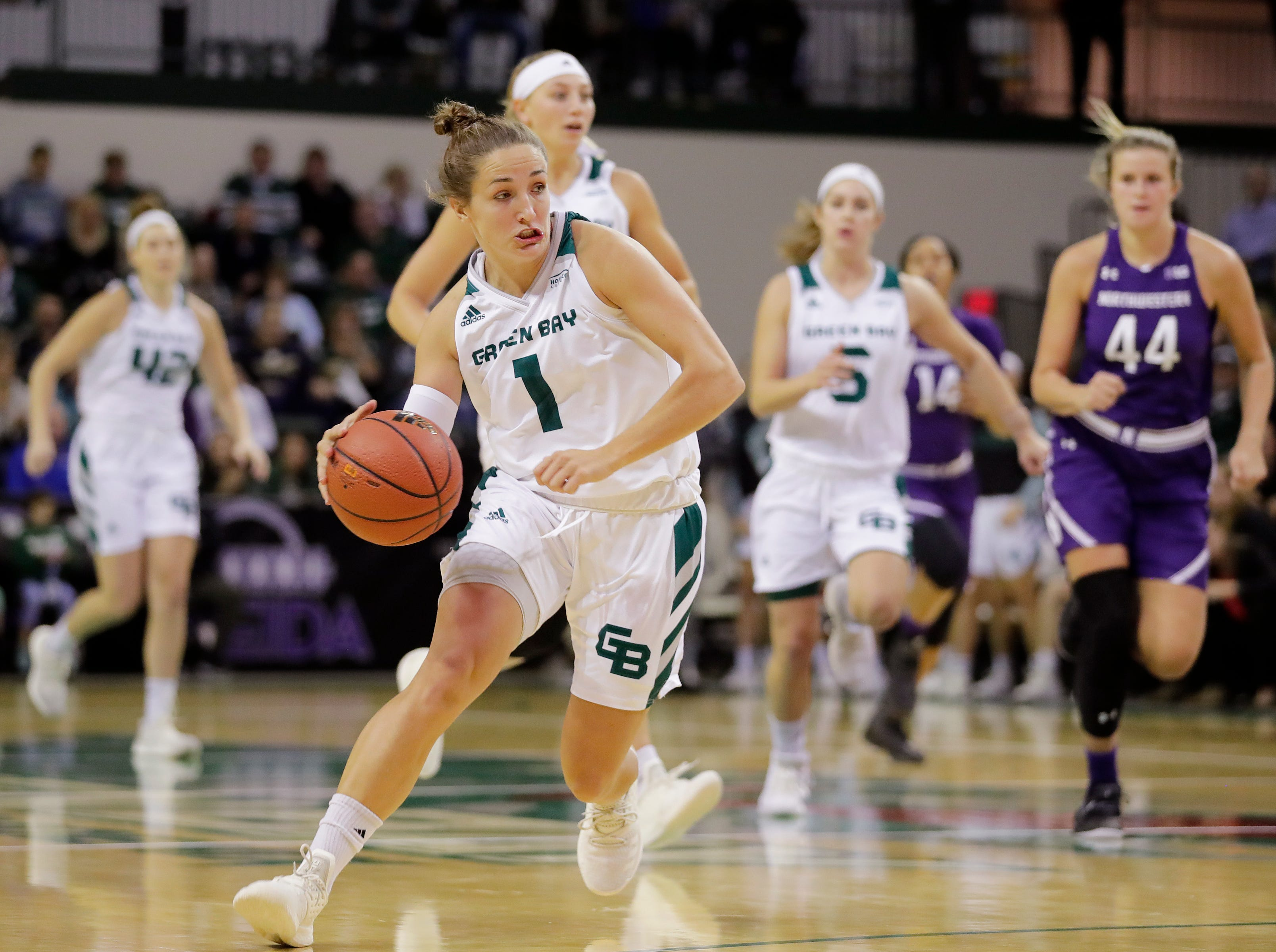 Green Bay Phoenix guard Jen Wellnitz (1) leads a breakaway against the Northwestern Wildcats in a women's NCAA basketball game at the Kress Center on Tuesday, November 6, 2018 in Green Bay, Wis.