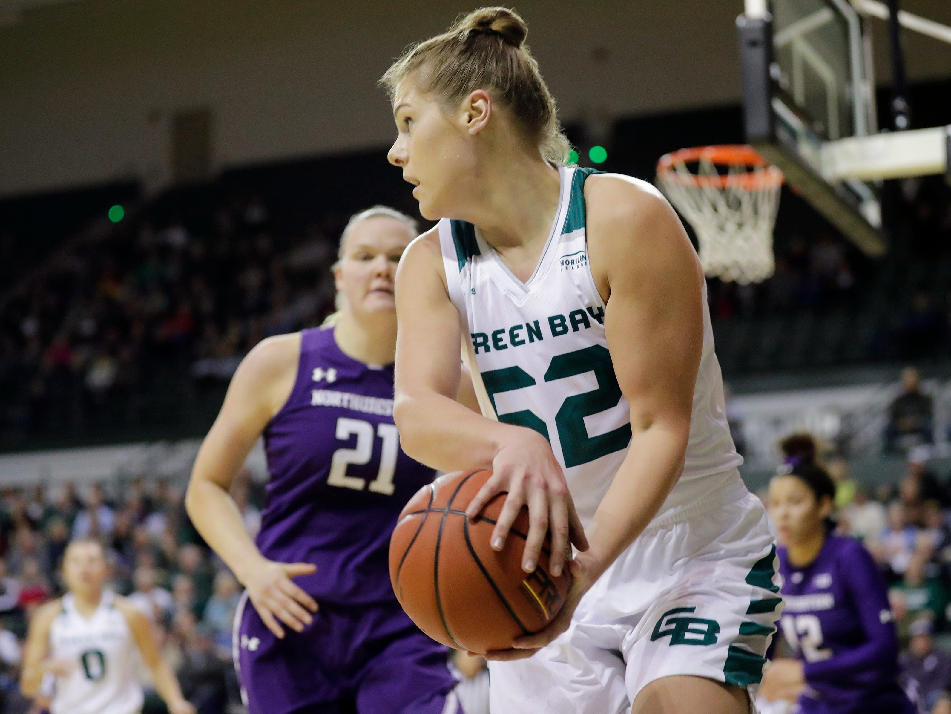 Green Bay Phoenix forward/center Madison Wolf (52) saves the ball from going out of bounds in a women's NCAA basketball game against the Northwestern Wildcats at the Kress Center on Tuesday, November 6, 2018 in Green Bay, Wis.