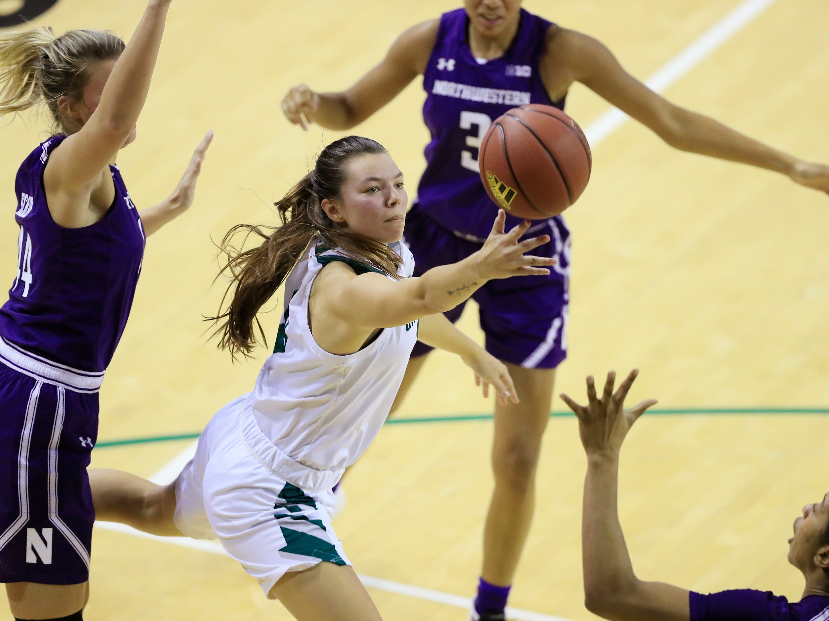 Green Bay Phoenix guard Hailey Oskey (0) shoots a layup against the Northwestern Wildcats in a women's NCAA basketball game at the Kress Center on Tuesday, November 6, 2018 in Green Bay, Wis.