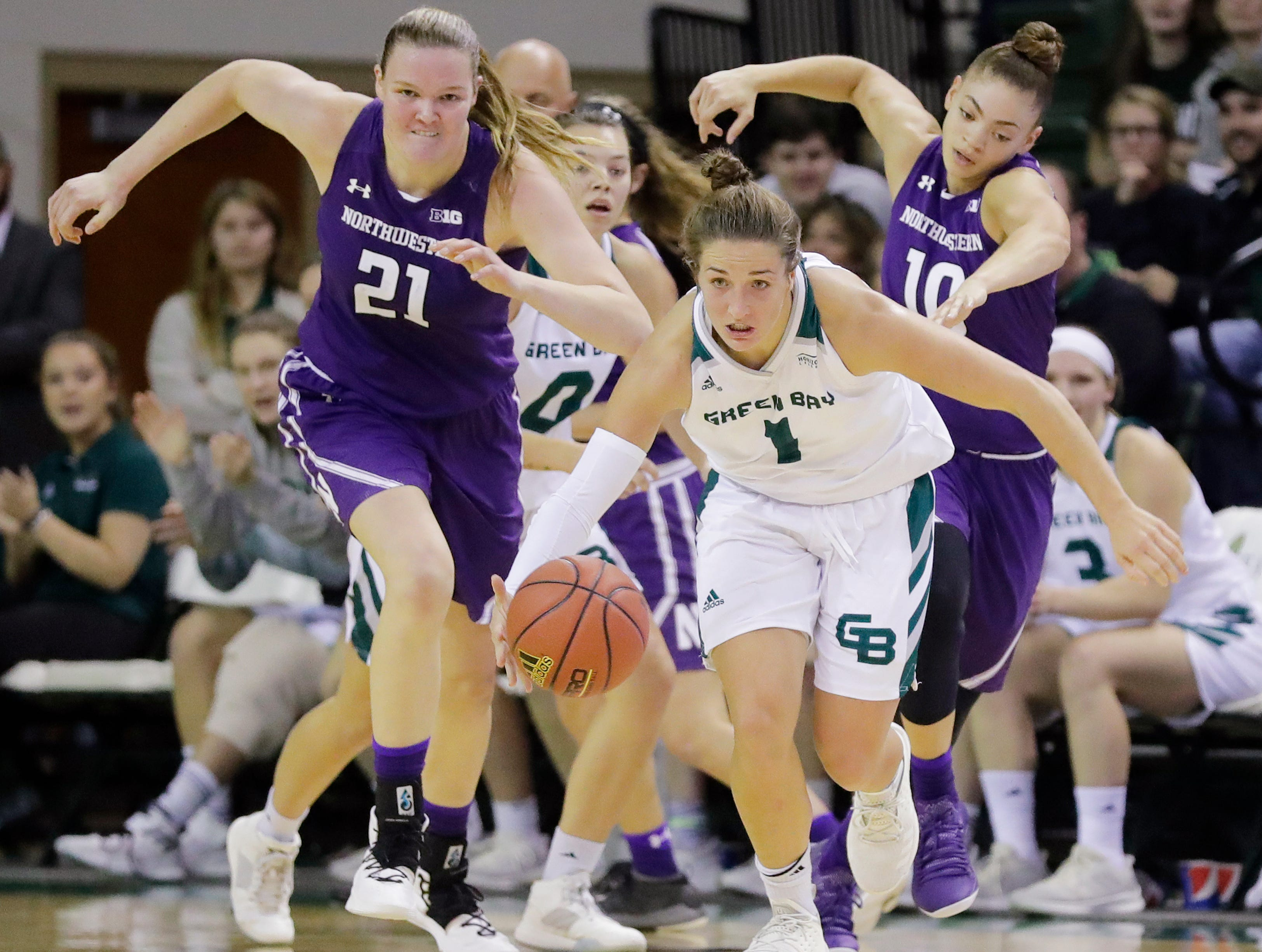 Green Bay Phoenix guard Jen Wellnitz (1) comes up with a steal against the Northwestern Wildcats in a women's NCAA basketball game at the Kress Center on Tuesday, November 6, 2018 in Green Bay, Wis.