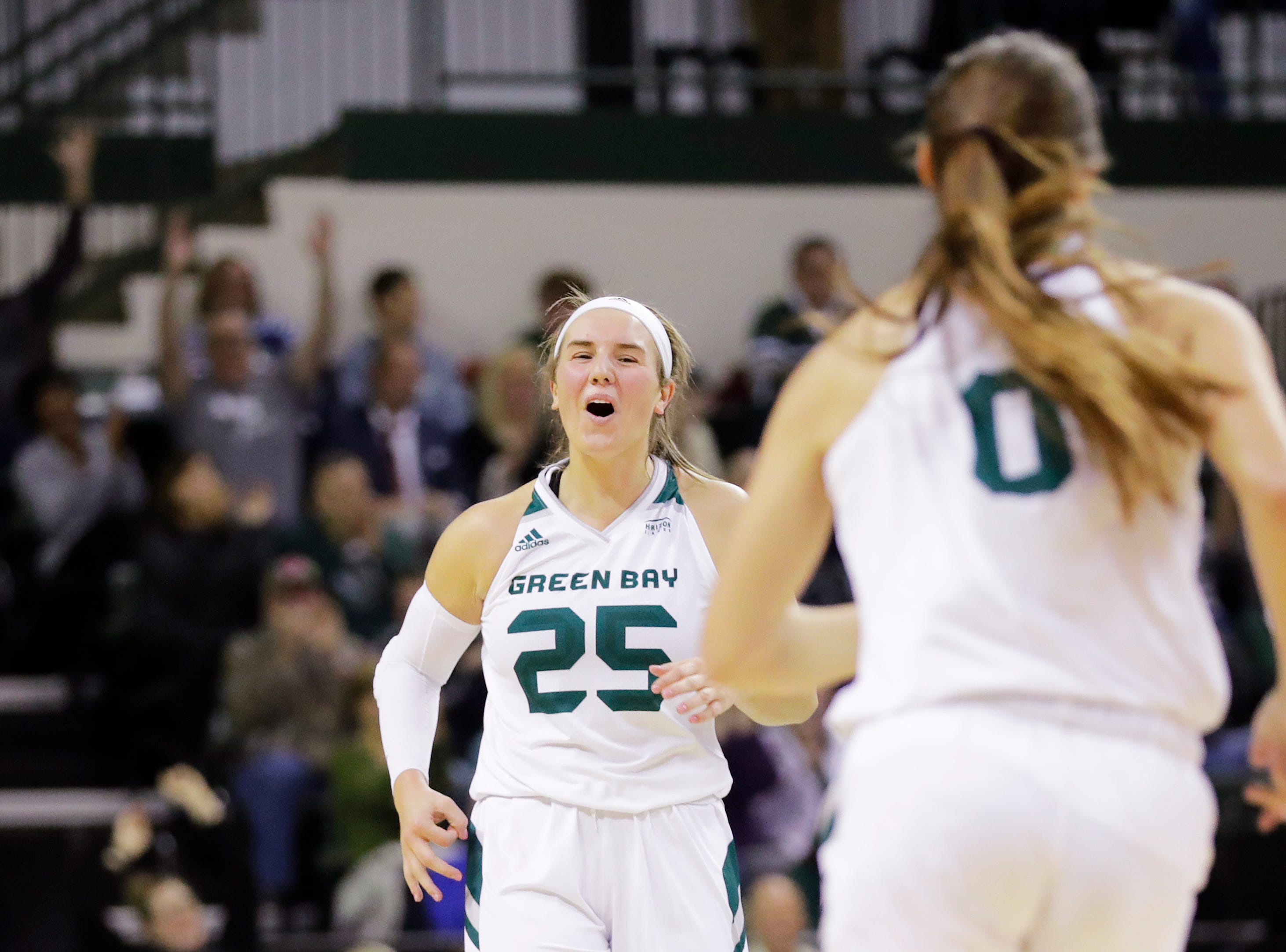 Green Bay Phoenix guard/forward Lyndsey Robson (25) reacts after guard Hailey Oskey (0) hit a 3-pointer against the Northwestern Wildcats in a women's NCAA basketball game at the Kress Center on Tuesday, November 6, 2018 in Green Bay, Wis.