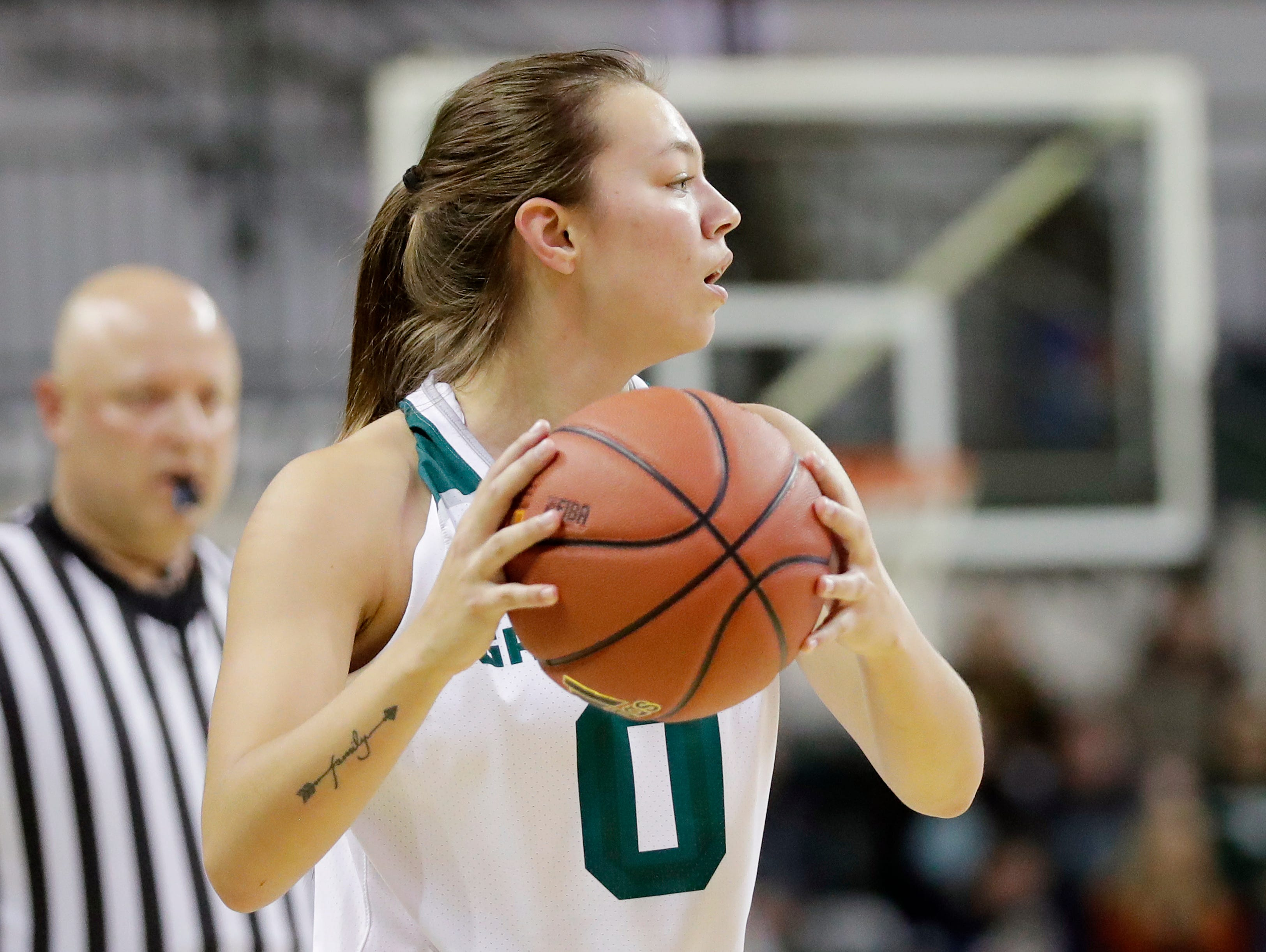 Green Bay Phoenix guard Hailey Oskey (0) brings the ball down the court against the Northwestern Wildcats in a women's NCAA basketball game at the Kress Center on Tuesday, November 6, 2018 in Green Bay, Wis.
