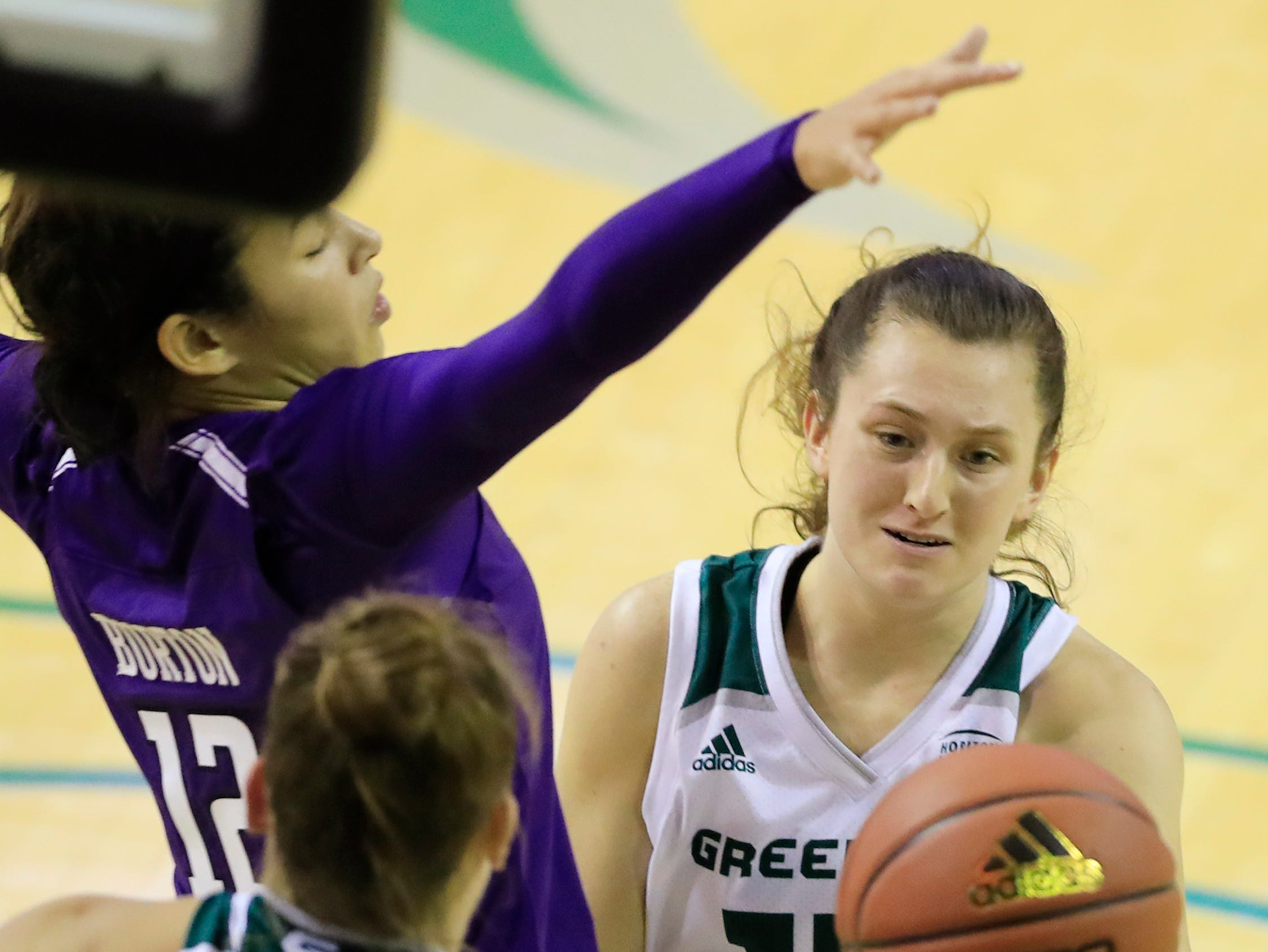 Green Bay Phoenix guard Meghan Pingel (14) fights for a rebound against the Northwestern Wildcats in a women's NCAA basketball game at the Kress Center on Tuesday, November 6, 2018 in Green Bay, Wis.