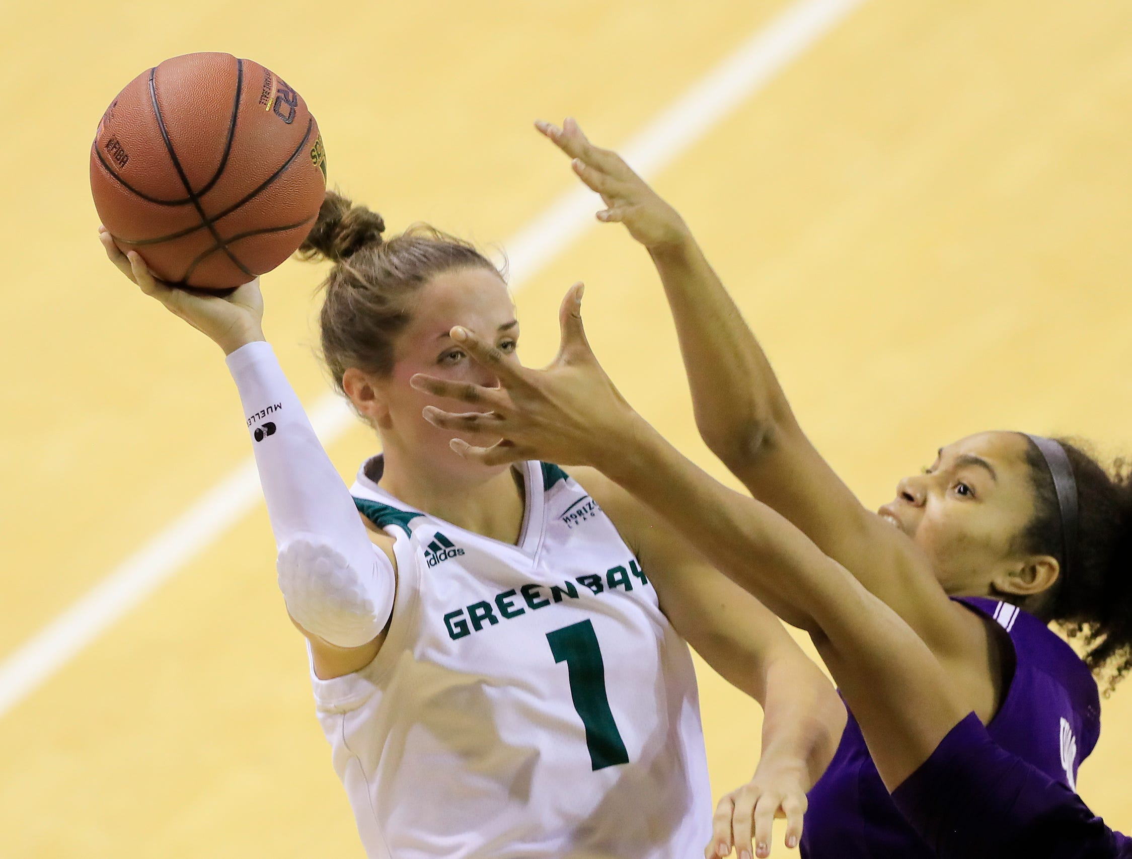 Green Bay Phoenix guard Jen Wellnitz (1) shoots under pressure against the Northwestern Wildcats in a women's NCAA basketball game at the Kress Center on Tuesday, November 6, 2018 in Green Bay, Wis.