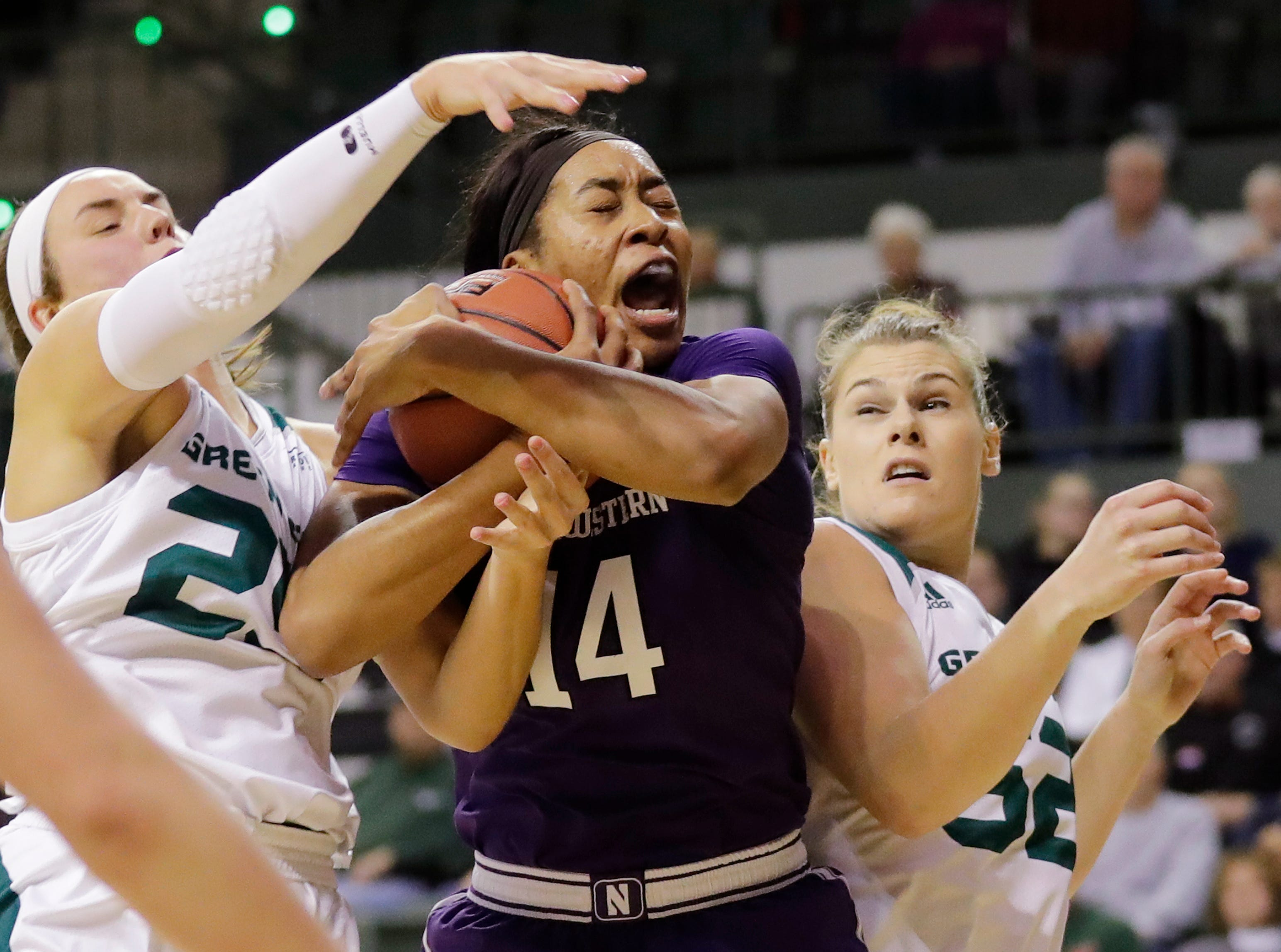 Northwestern Wildcats forward Pallas Kunaiyi-Akpanah (14) gets a rebound against the Green Bay Phoenix in a women's NCAA basketball game at the Kress Center on Tuesday, November 6, 2018 in Green Bay, Wis.