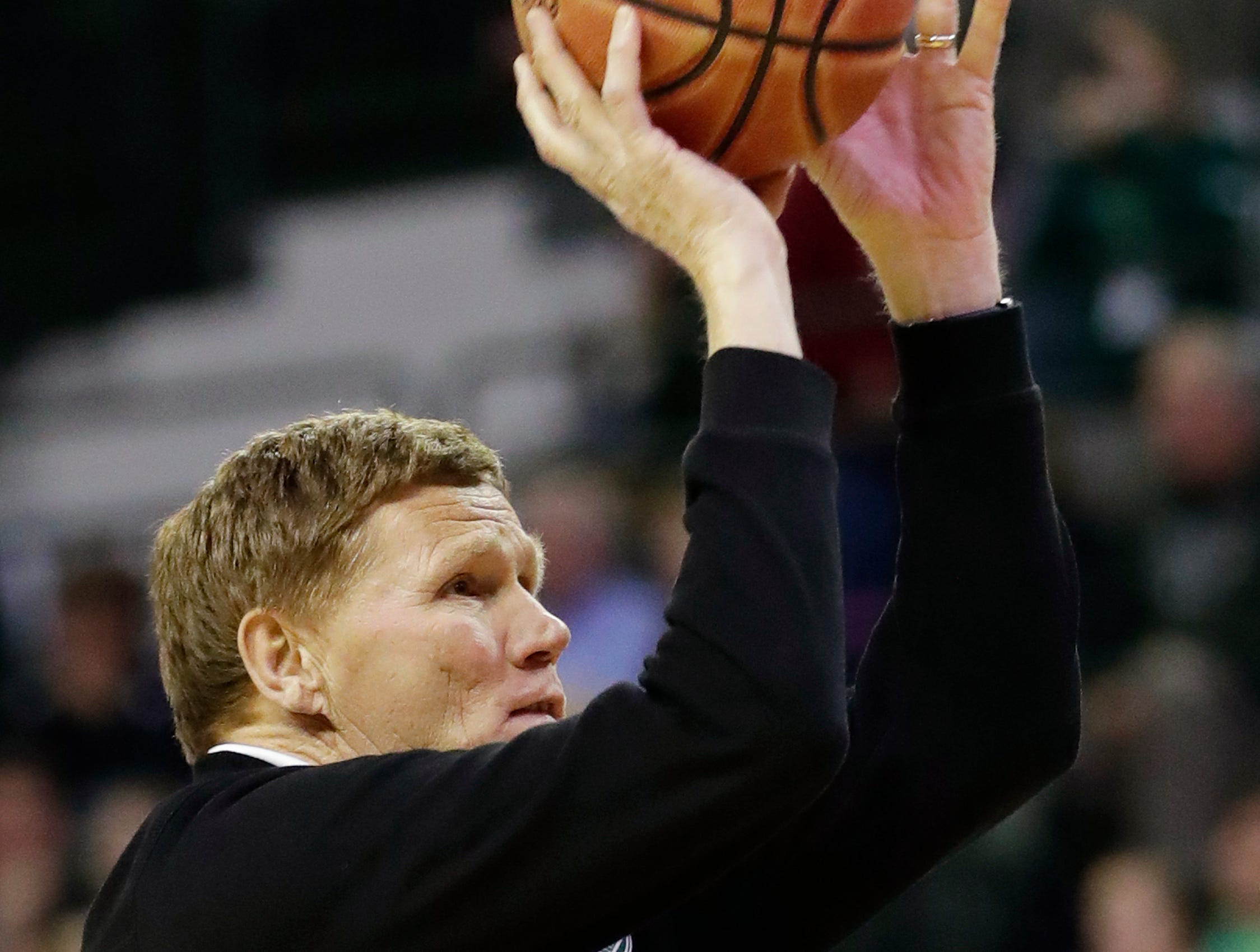 Green Bay Packers CEO Mark Murphy shoots free throws at a women's NCAA basketball game at the Kress Center on Tuesday, November 6, 2018 in Green Bay, Wis.