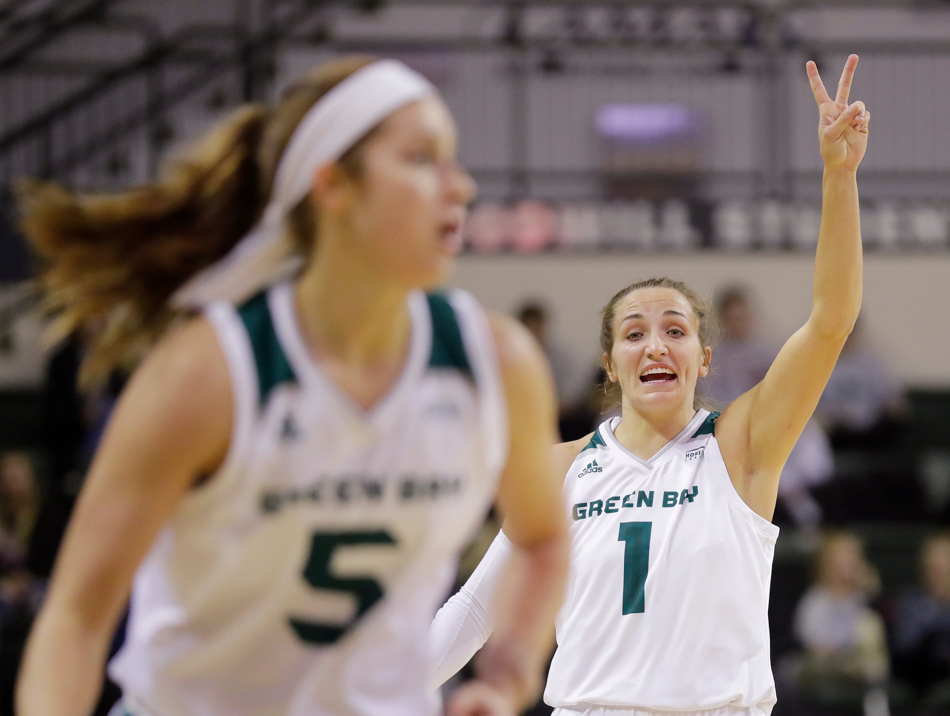 Green Bay Phoenix guard Jen Wellnitz (1) calls out to guard Laken James (5) in a women's NCAA basketball game against the Northwestern Wildcats at the Kress Center on Tuesday, November 6, 2018 in Green Bay, Wis.