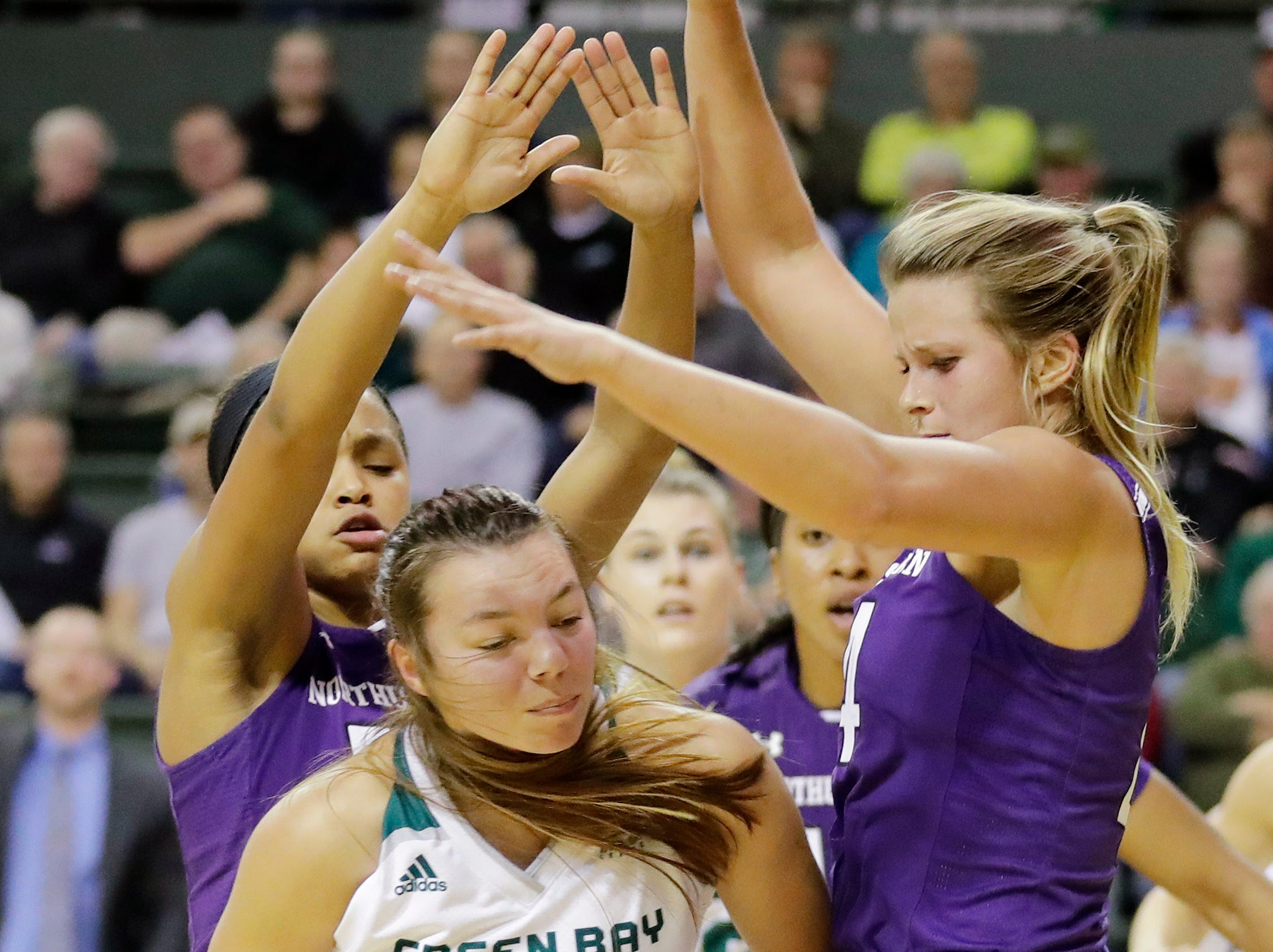 Green Bay Phoenix guard Hailey Oskey (0) draws a foul against the Northwestern Wildcats in a women's NCAA basketball game at the Kress Center on Tuesday, November 6, 2018 in Green Bay, Wis.