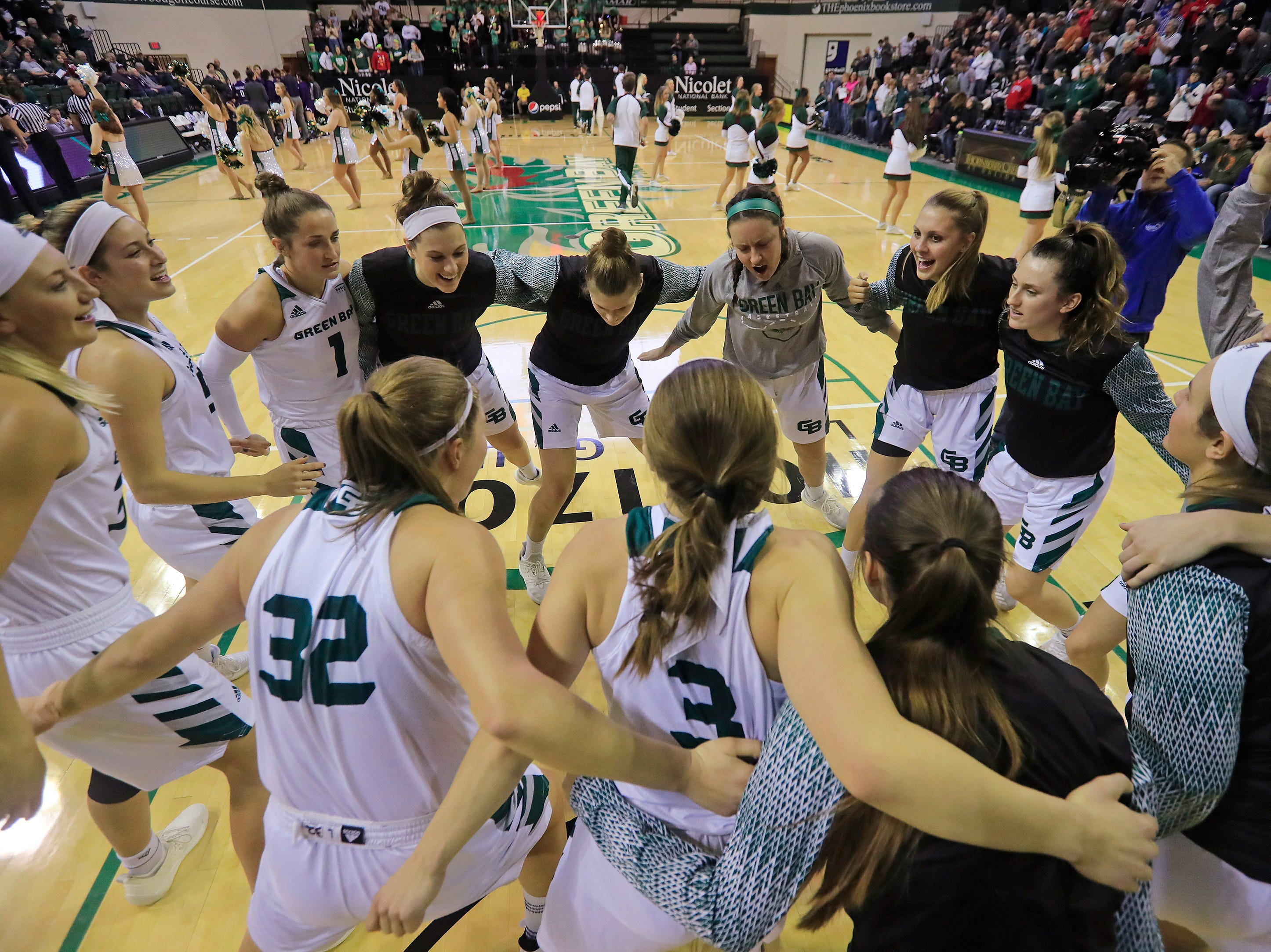 Green Bay Phoenix players huddle before facing the Northwestern Wildcats in a women's NCAA basketball game at the Kress Center on Tuesday, November 6, 2018 in Green Bay, Wis.