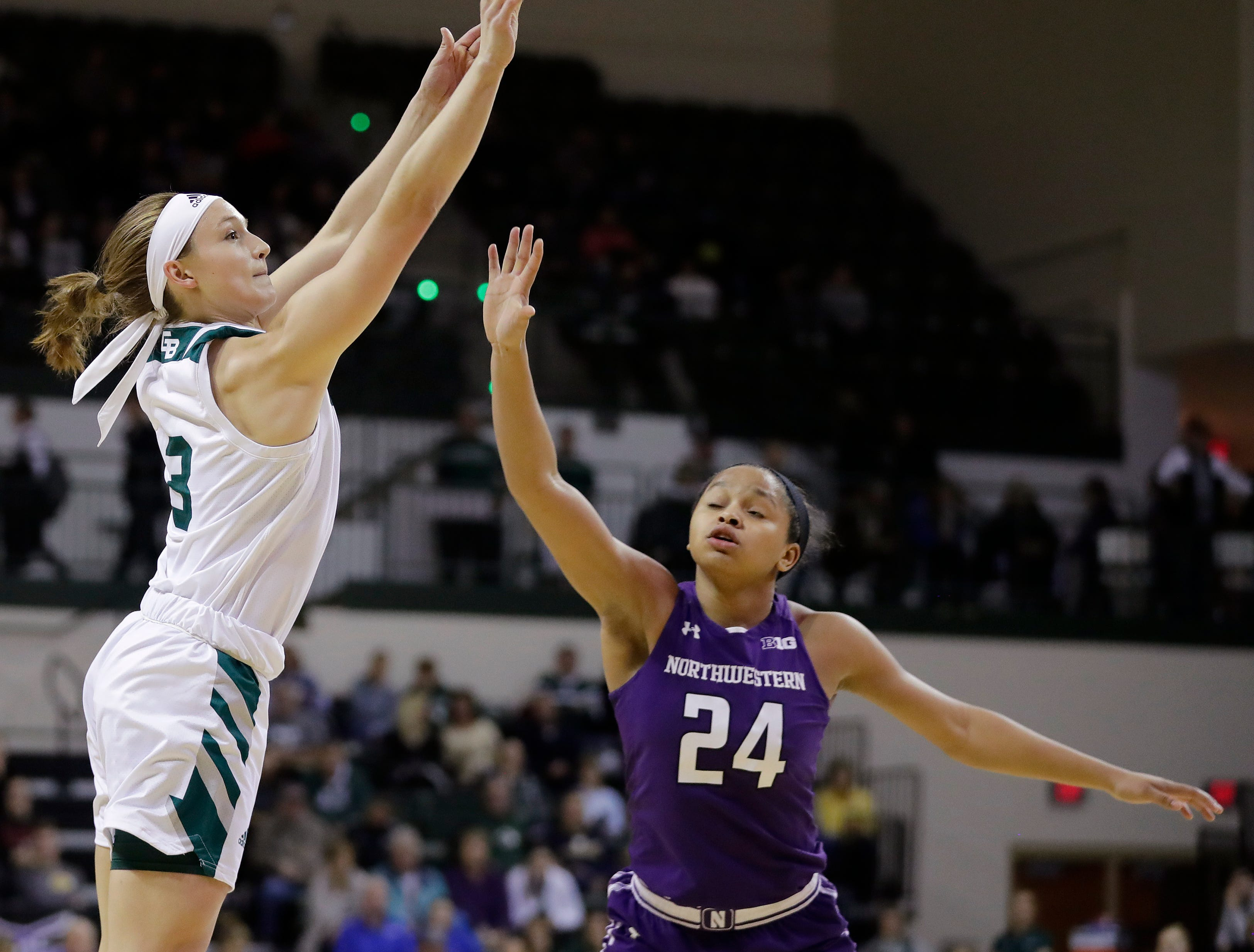 Green Bay Phoenix guard Frankie Wurtz (3) shoots over Northwestern Wildcats guard Jordan Hamilton (24) in a women's NCAA basketball game at the Kress Center on Tuesday, November 6, 2018 in Green Bay, Wis.