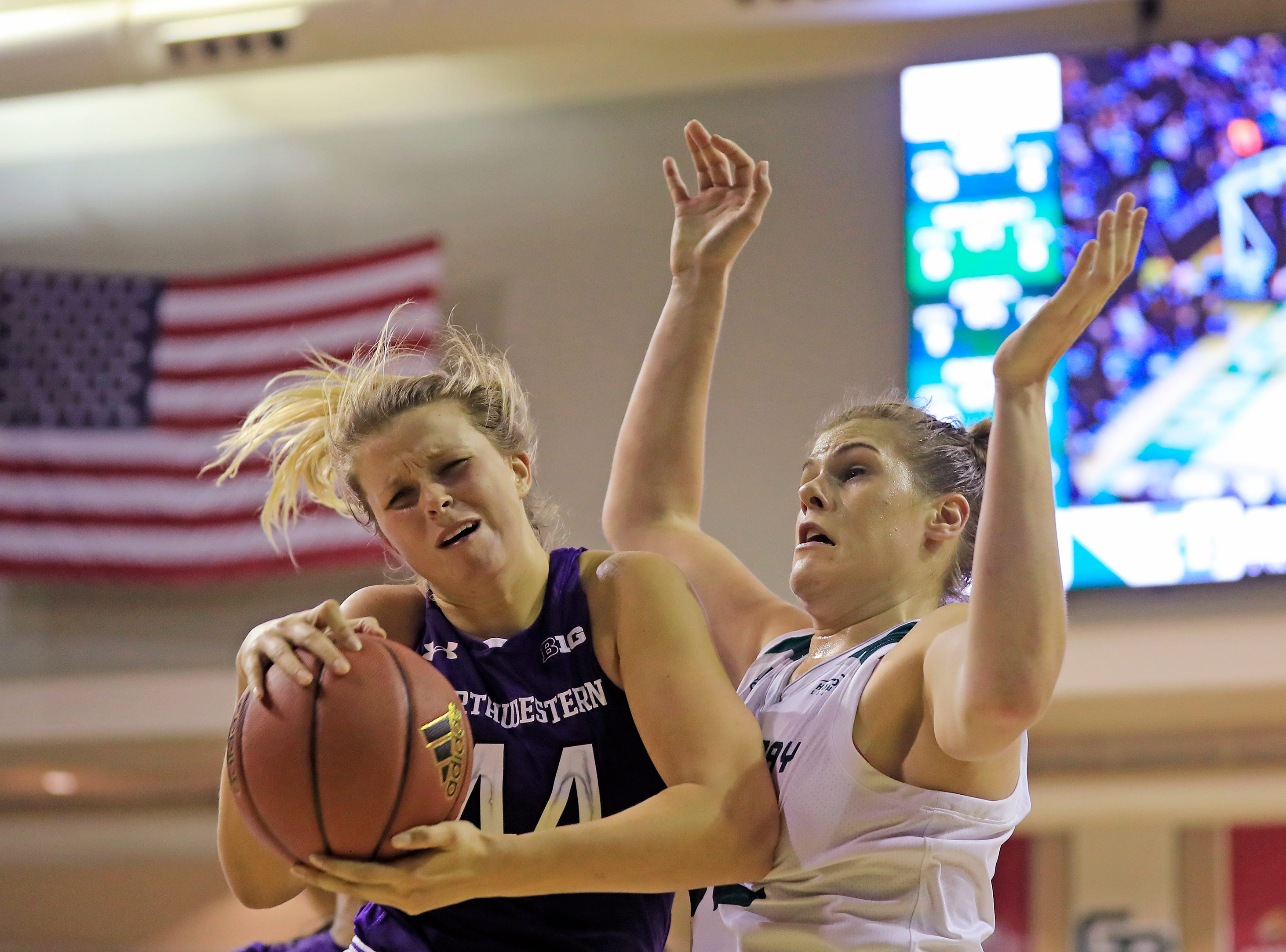 Northwestern Wildcats forward/center Abi Scheid (44) grabs a rebound in the final minute against Green Bay Phoenix forward/center Mackenzie Wolf (42) in a women's NCAA basketball game at the Kress Center on Tuesday, November 6, 2018 in Green Bay, Wis.