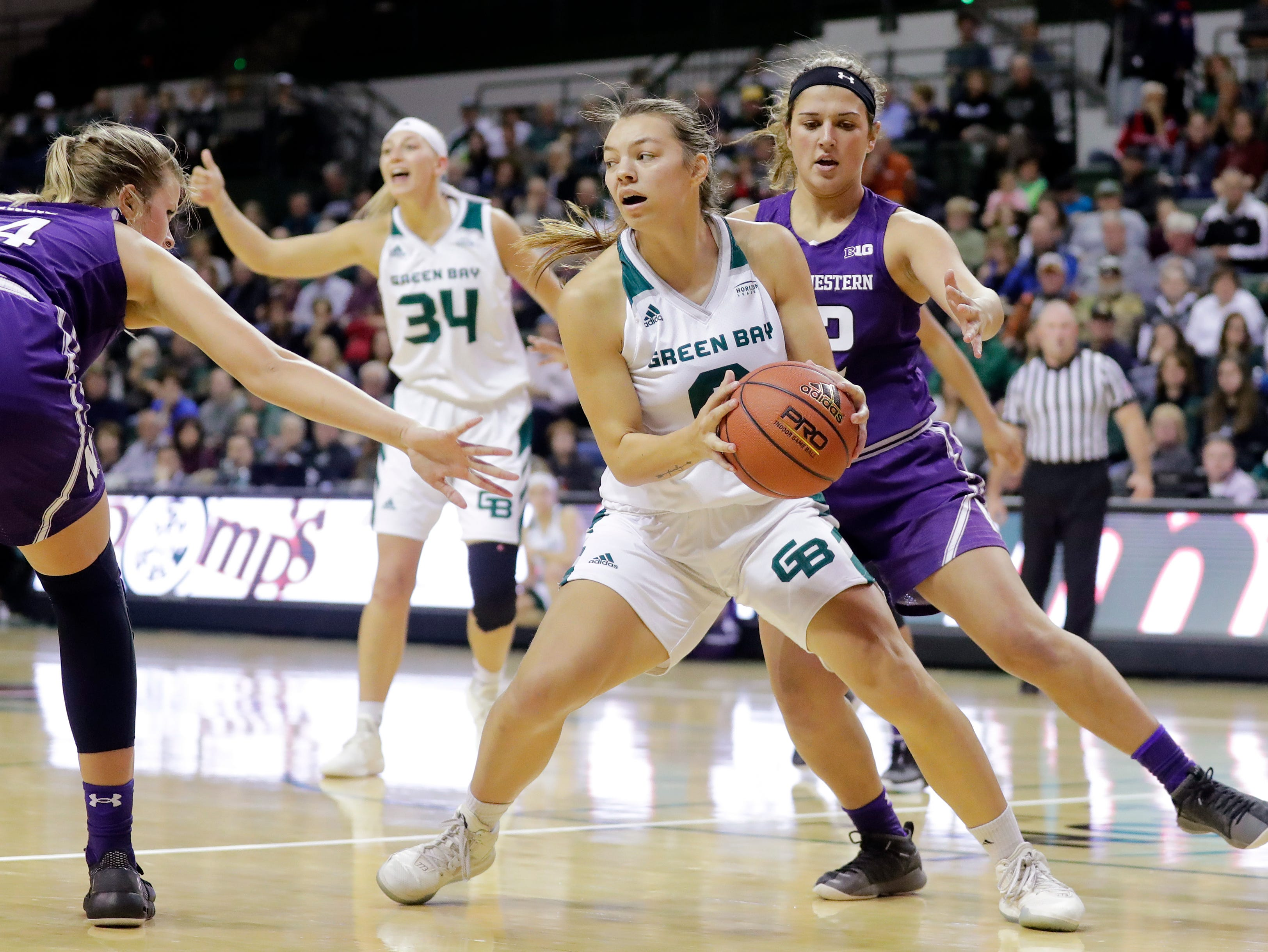 Green Bay Phoenix guard Hailey Oskey (0) passes against the Northwestern Wildcats in a women's NCAA basketball game at the Kress Center on Tuesday, November 6, 2018 in Green Bay, Wis.