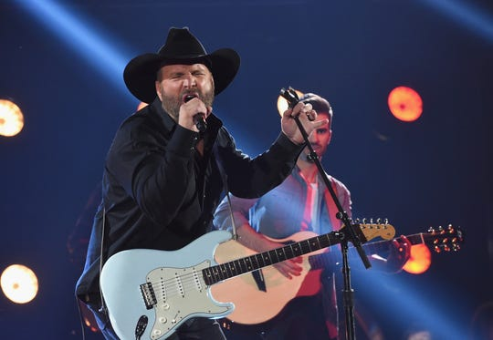 Garth Brooks performs at the CMA Awards in 2017 in Nashville. He announced he'll be playing stadiums in 2019, but has only revealed two stops so far.