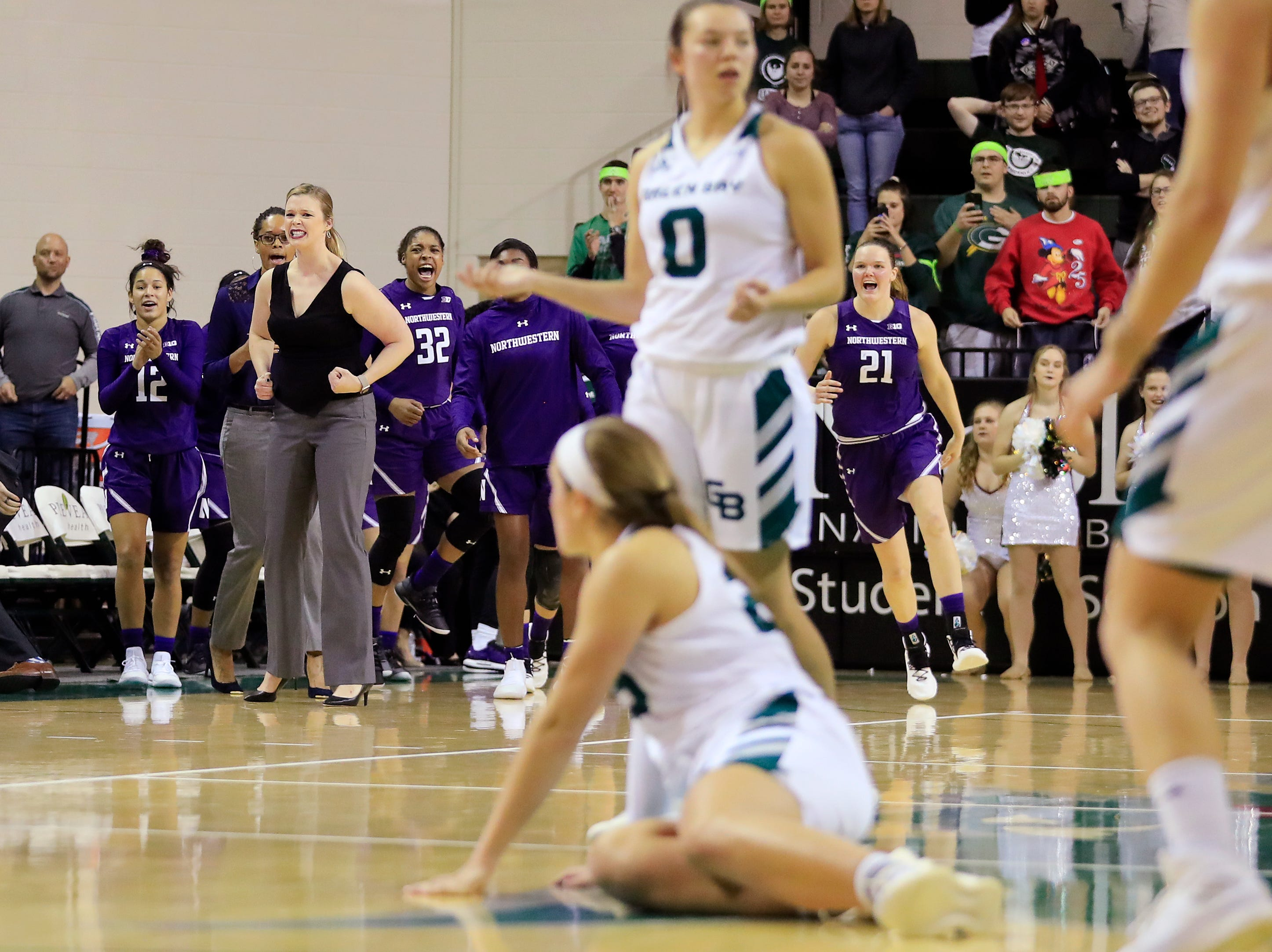 Northwestern Wildcats players react as they defeat the Green Bay Phoenix in a women's NCAA basketball game at the Kress Center on Tuesday, November 6, 2018 in Green Bay, Wis.
