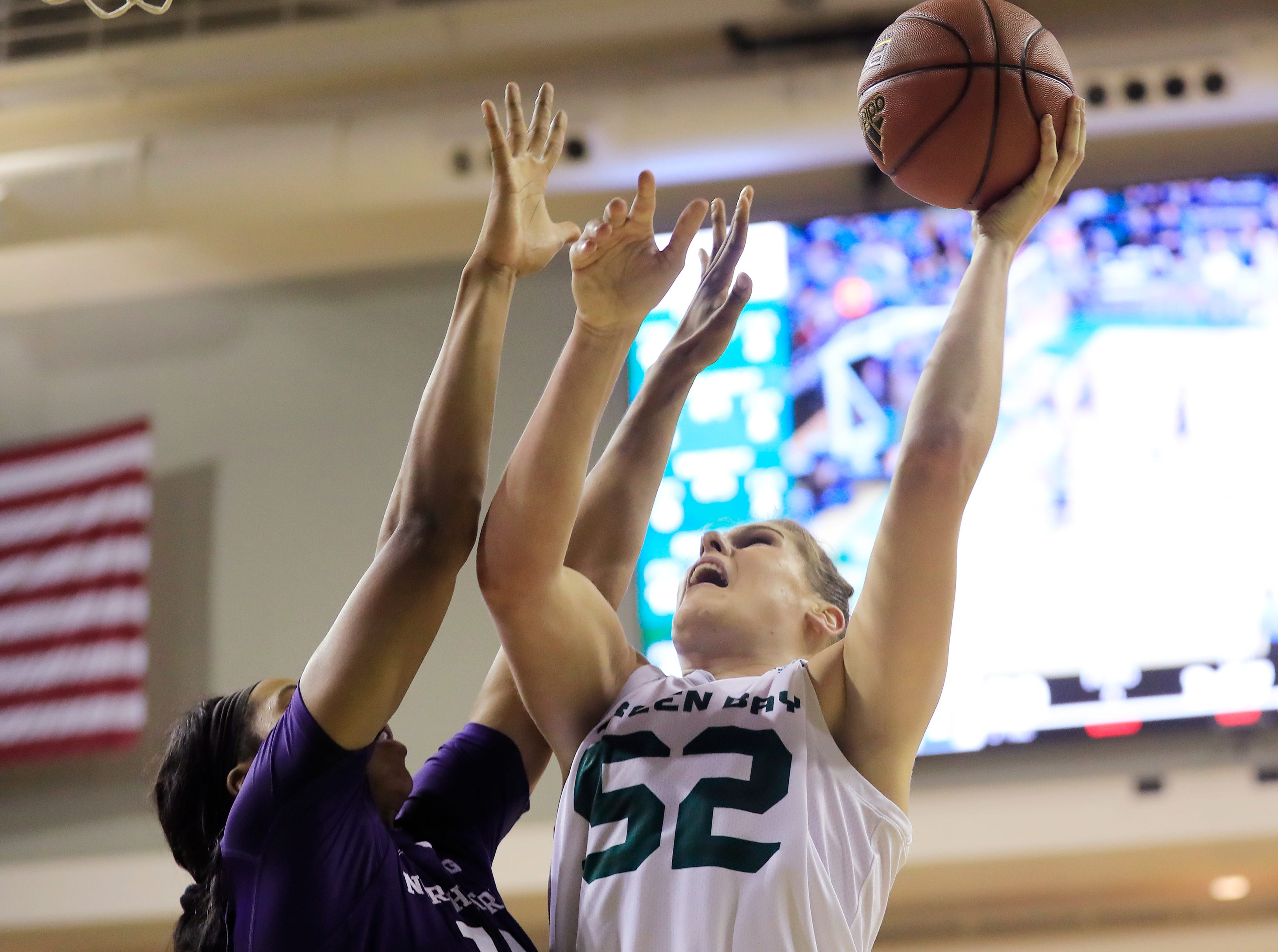 Green Bay Phoenix forward/center Madison Wolf (52) drives to the basket against Northwestern Wildcats forward Pallas Kunaiyi-Akpanah (14) in a women's NCAA basketball game at the Kress Center on Tuesday, November 6, 2018 in Green Bay, Wis.