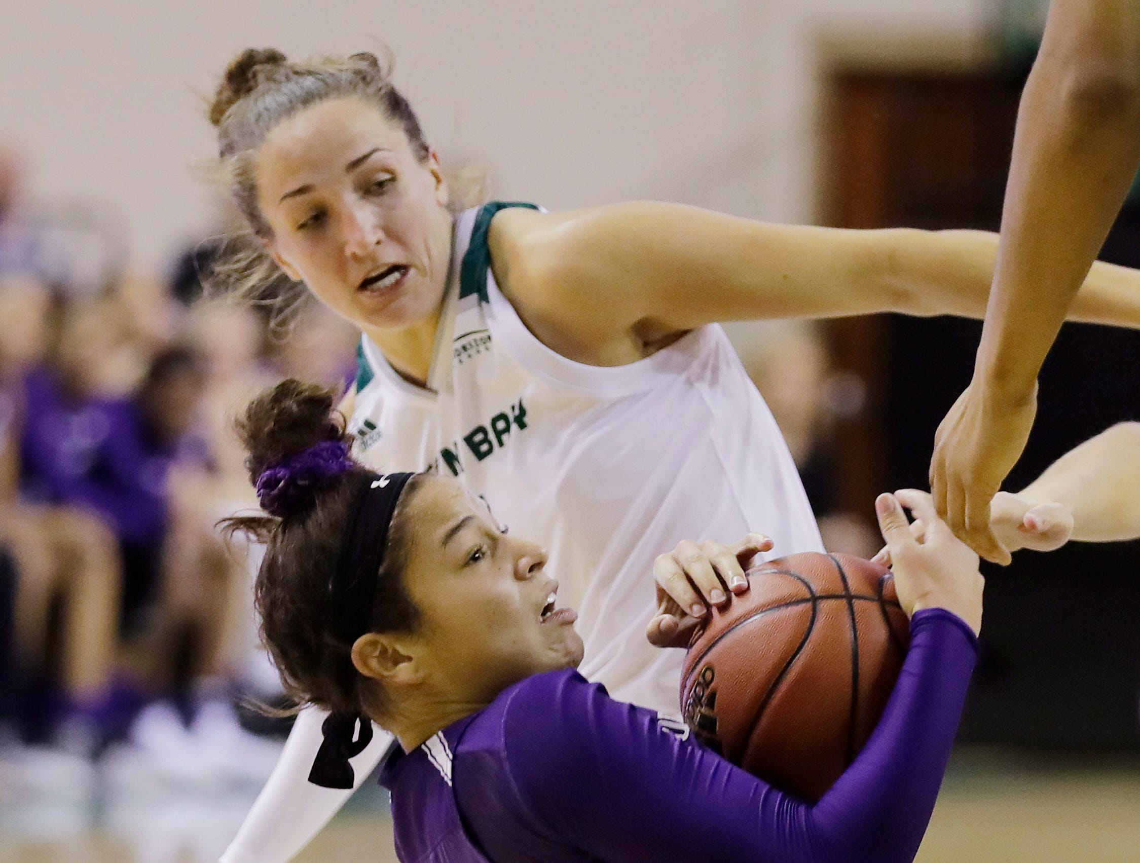 Northwestern Wildcats guard Veronica Burton (12) comes up with a loose ball against Green Bay Phoenix guard Jen Wellnitz (1) in a women's NCAA basketball game at the Kress Center on Tuesday, November 6, 2018 in Green Bay, Wis.
