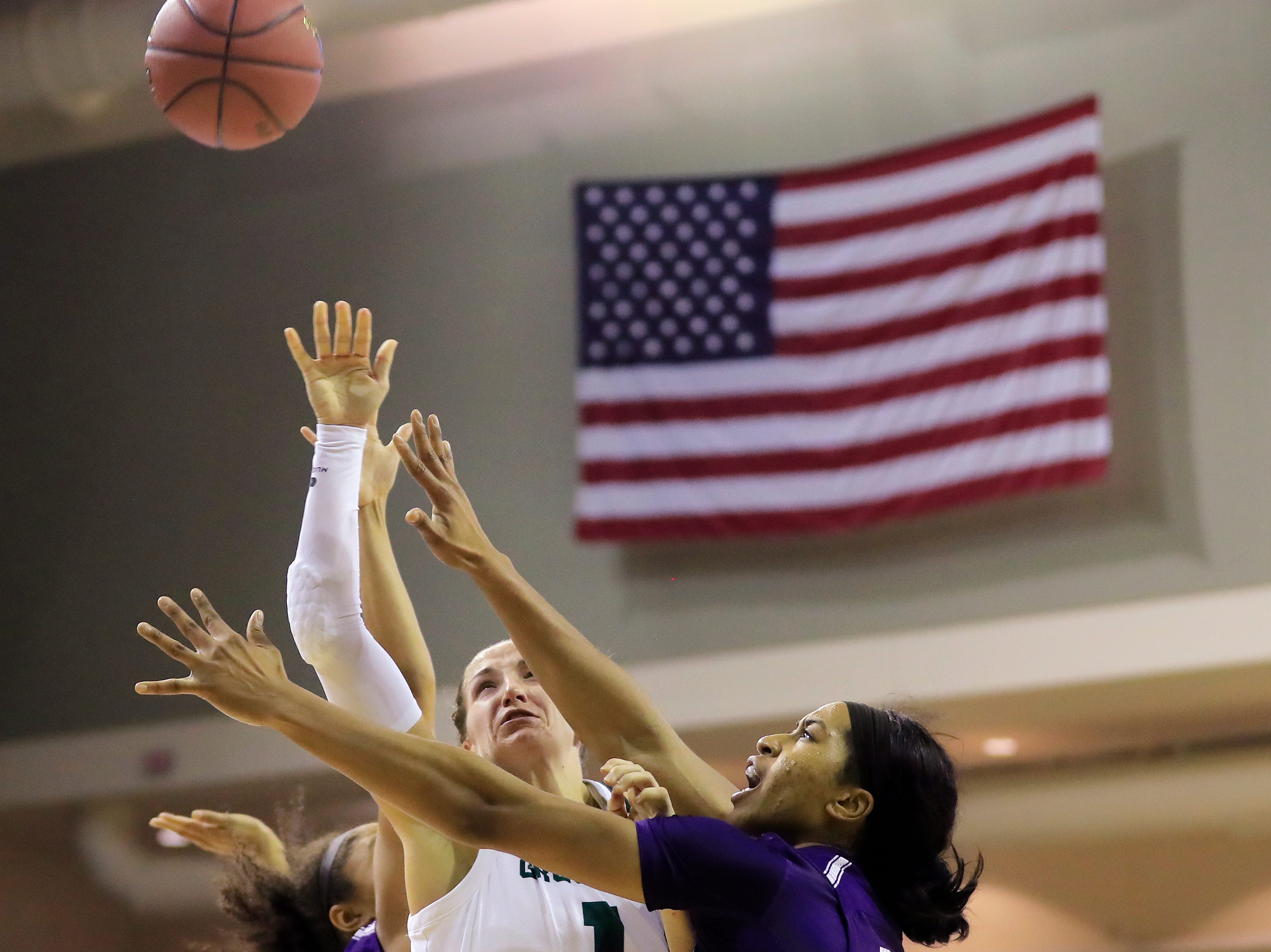 Green Bay Phoenix guard Jen Wellnitz (1) shoots a contested basket against the Northwestern Wildcats in a women's NCAA basketball game at the Kress Center on Tuesday, November 6, 2018 in Green Bay, Wis.