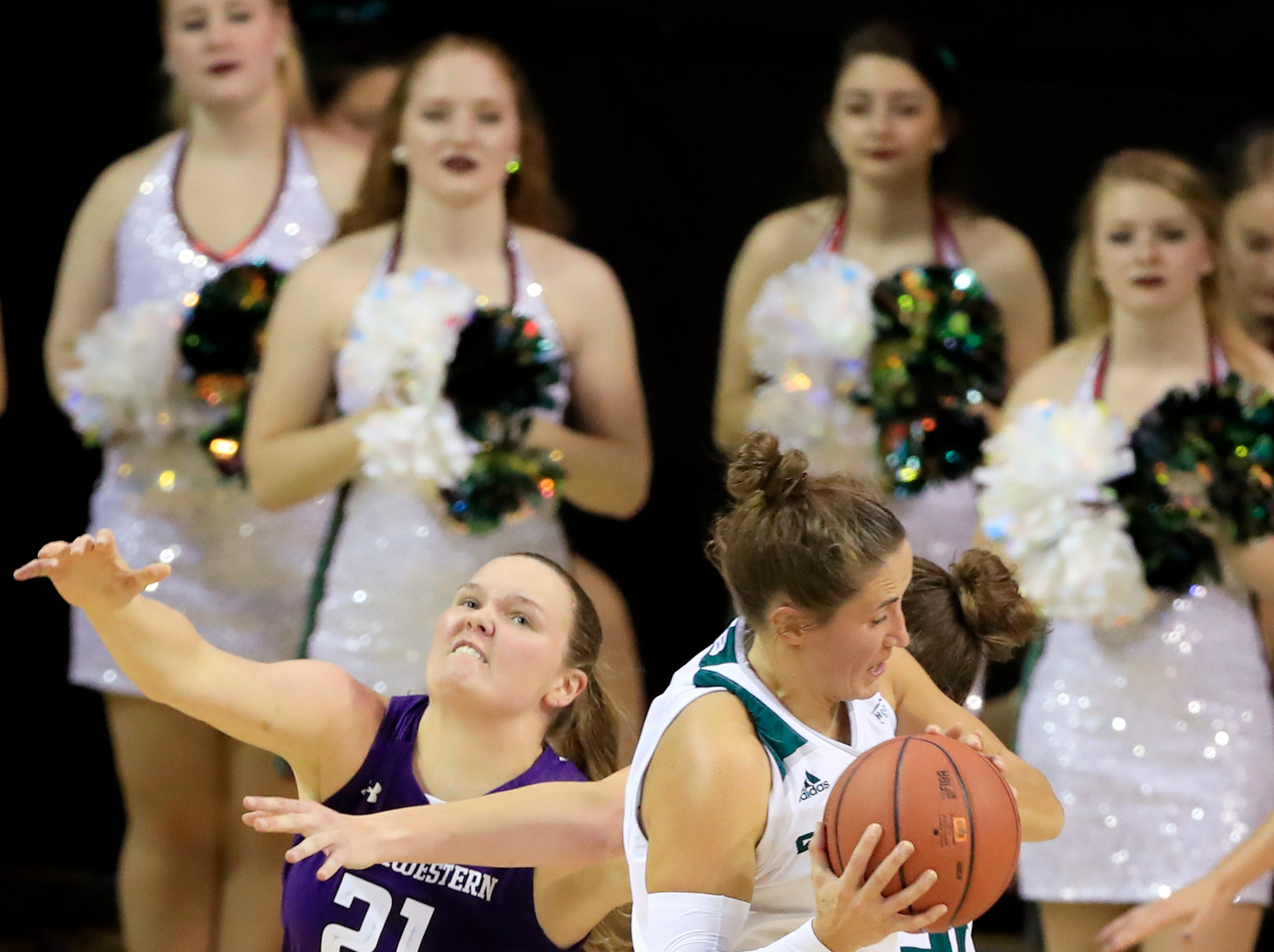Green Bay Phoenix guard Jen Wellnitz (1) grabs a rebound against Northwestern Wildcats forward/center Abbie Wolf (21) in a women's NCAA basketball game at the Kress Center on Tuesday, November 6, 2018 in Green Bay, Wis.