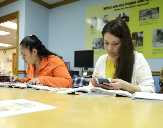 Yolanda Arellano (right) and Maria Velazquez participate in a Spanish-language GED math class at Casa ALBA Melanie, the Green Bay-area Hispanic Resource Center.