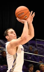 Furman's Andrew Brown (5) fires a three pointer against Bob Jones Tuesday, November 6, 2018, at Timmons Arena.