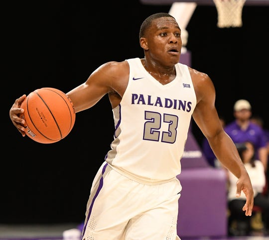 Furman's Jordan Lyons (23) tries to find a shot against Bob Jones Tuesday, November 6, 2018, at Timmons Arena.