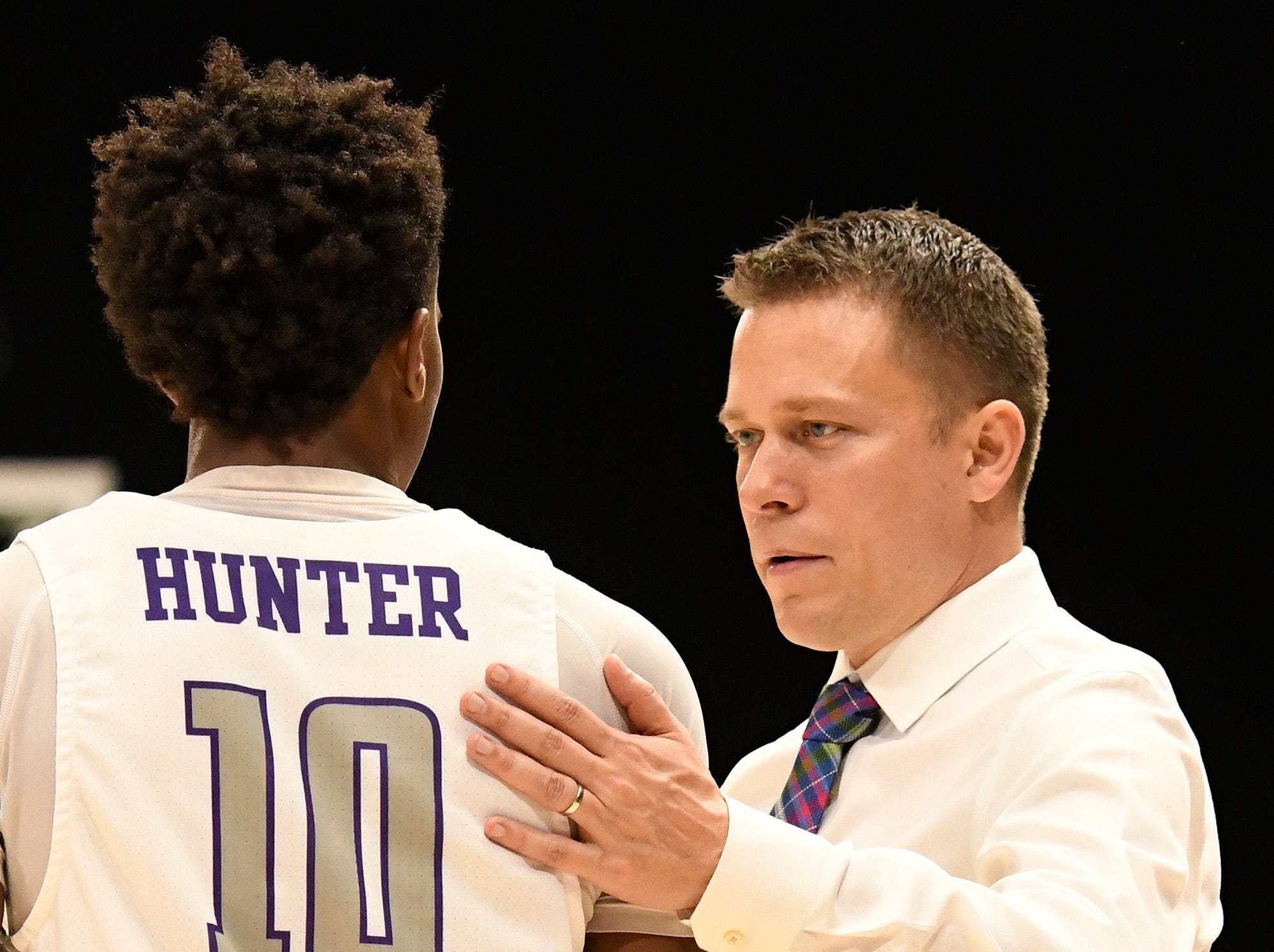 Furman head basketball coach Bob Richey speaks with Alex Hunter (10) while hosting Bob Jones Tuesday, November 6, 2018, at Timmons Arena.