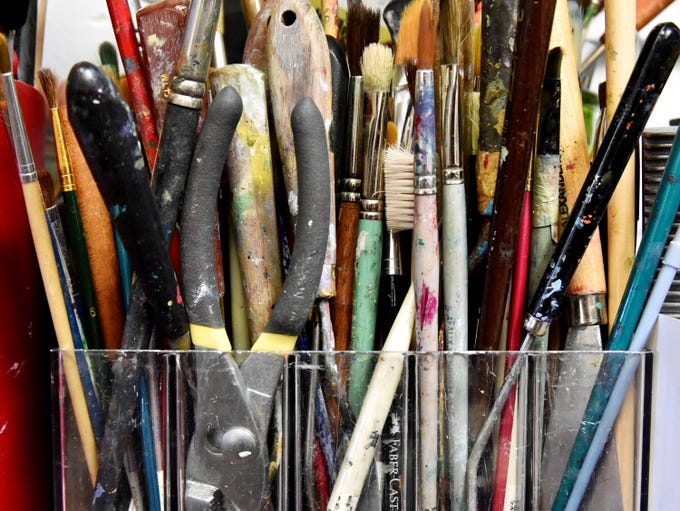 Brushes and other tools used by artist Julia Peters.