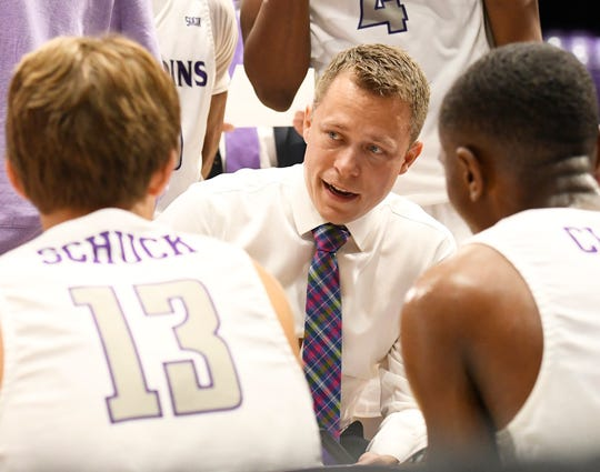Furman head basketball coach Bob Richey speaks with this team while hosting Bob Jones Tuesday, November 6, 2018, at Timmons Arena.