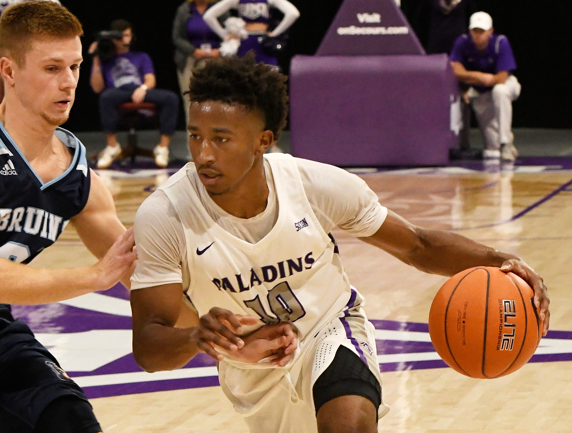 Furman's Alex Hunter (10) drives against Bob Jones Tuesday, November 6, 2018, at Timmons Arena.