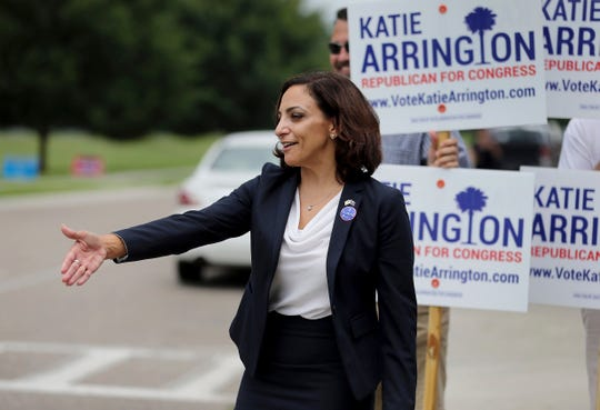 In this June 12, 2018 photo, state Rep. Katie Arrington, who is running for the 1st Congressional District, greets primary voters at the Daniel Island School in Charleston, S.C. Arrington, a Republican who survived a serious car crash just days after the June Republican primary where she defeated U.S. Rep. Mark Sanford, is running against Democrat Joe Cunningham. (Grace Beahm Alford/The Post And Courier via AP)