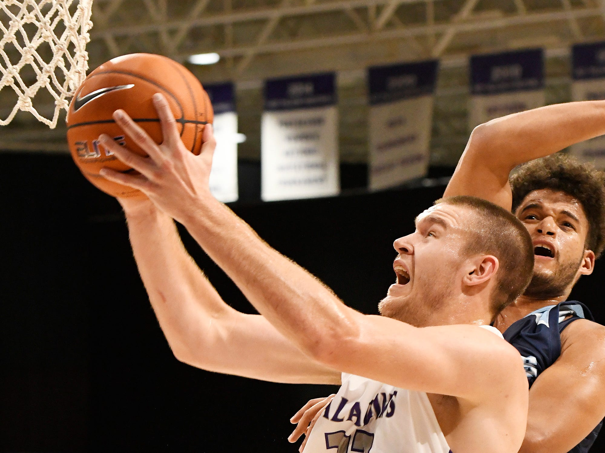 Furman's Matt Rafferty (32) draws a foul from a  Bob Jones  defender Tuesday, November 6, 2018, at Timmons Arena.