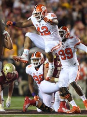 Christian Wilkins (42) celebrates a sack at Boston College in 2016.