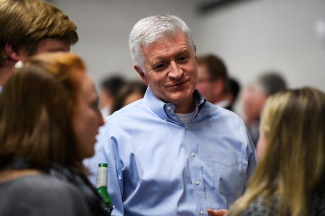 State Rep. Jason Elliot, who is running for reelection in district 22, speaks with members of the public during an election watch party at Swamp Rabbit CrossFit on Tuesday, Nov 6, 2018.