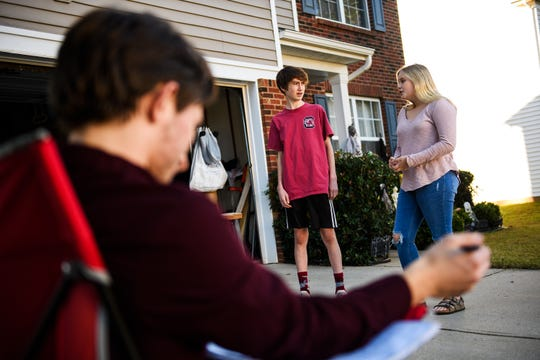 Aden Connor, 15, left, and Emily Abercrombie, 15, rehearse a scene as Ryan George, 19, observes on Monday, Oct. 29, 2018.
