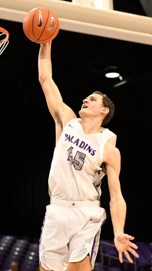Furman's Clay Mounce (45) dunks against Bob Jones Tuesday, November 6, 2018, at Timmons Arena.