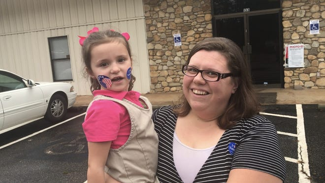 Pickens voter Susan Bolding, with her daughter Callysta, said education was her most important issue in Tuesday's elections.