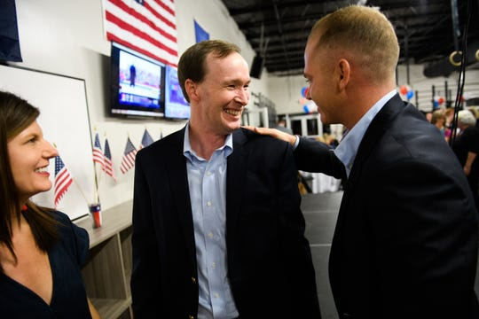 Solicitor Walt Wilkins hugs William Timmons after giving his victory speech for the 13th circuit solicitor race during an election watch party at Swamp Rabbit CrossFit on Tuesday, Nov 6, 2018.